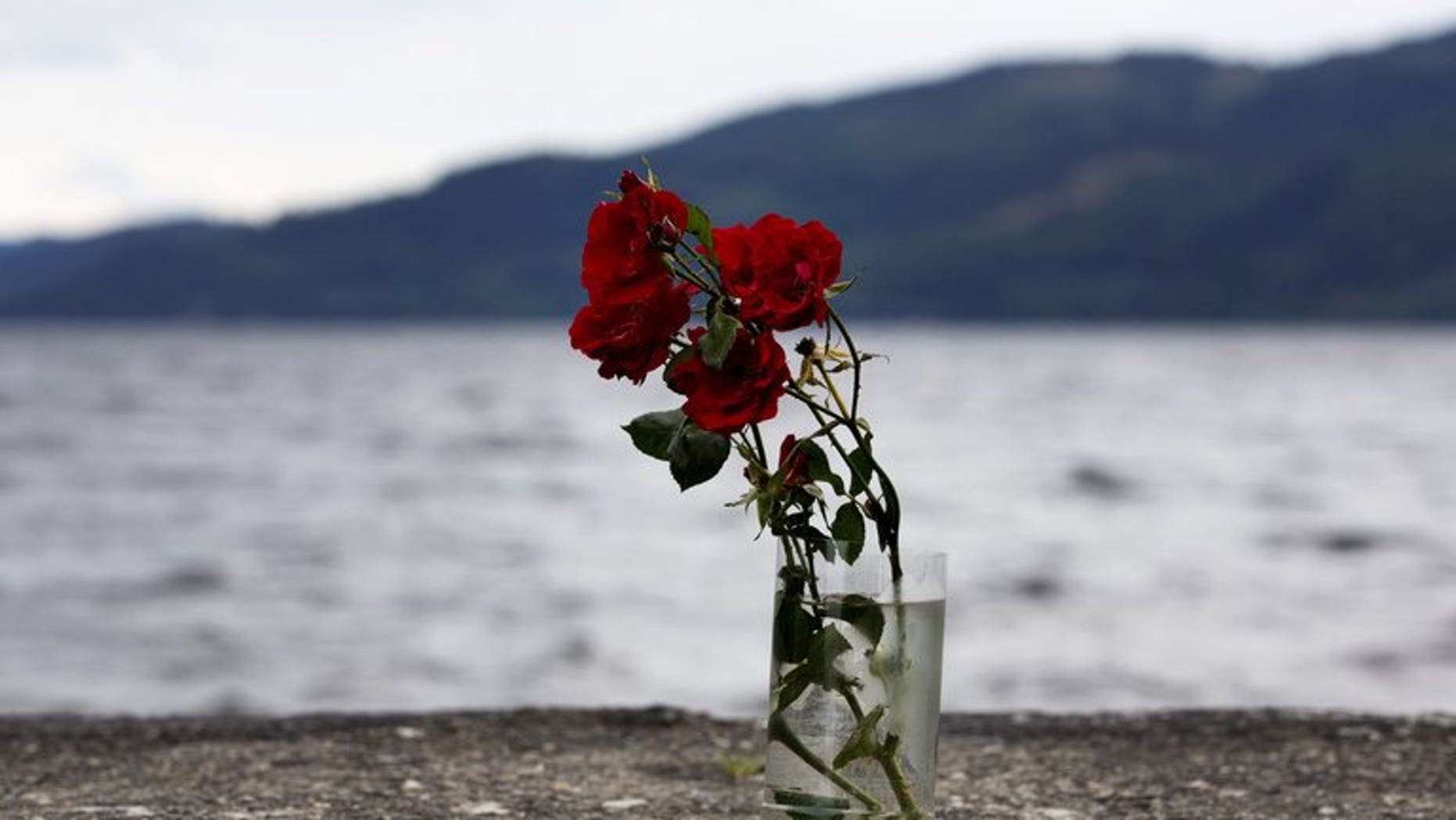 Flowers in a vase are pictured on the shores of Utoeya Island on July 22, 2012 where Anders Behring Breivik killed dozens at a Labor Party summer camp. The camp reconvened at a new site for the first time.