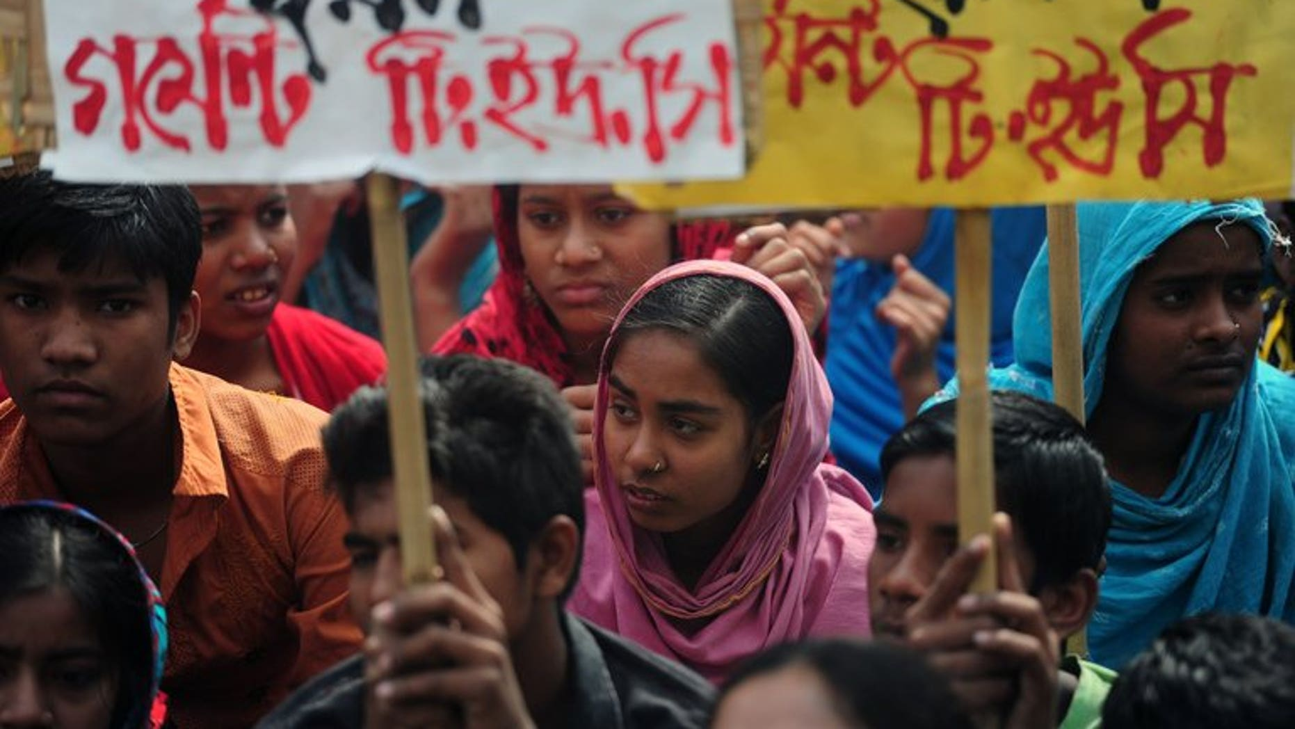 Bangladeshi garments workers and activists stage a protest in front of the Bangladesh Garment Manufactures & Exporters Association (BGMEA) office in Dhaka on January 28, 2013. Bangladesh has decided to review already announced labour law reforms after the United States last week cut its trade privileges over a deadly garment factory collapse, officials said Wednesday.