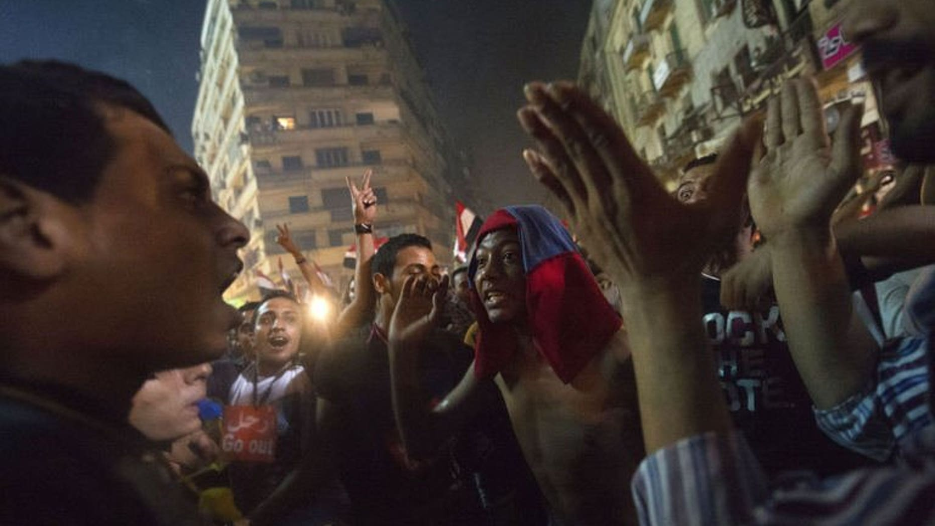 People celebrate at Tahrir Square after the announcement that President Mohamed Morsi was being toppled, on July 3, 2013 in Cairo. Egypt's new caretaker president Adly Mansour had been head of the Supreme Constitutional Court for just two days when the army named him leader of the Arab world's most populous state.