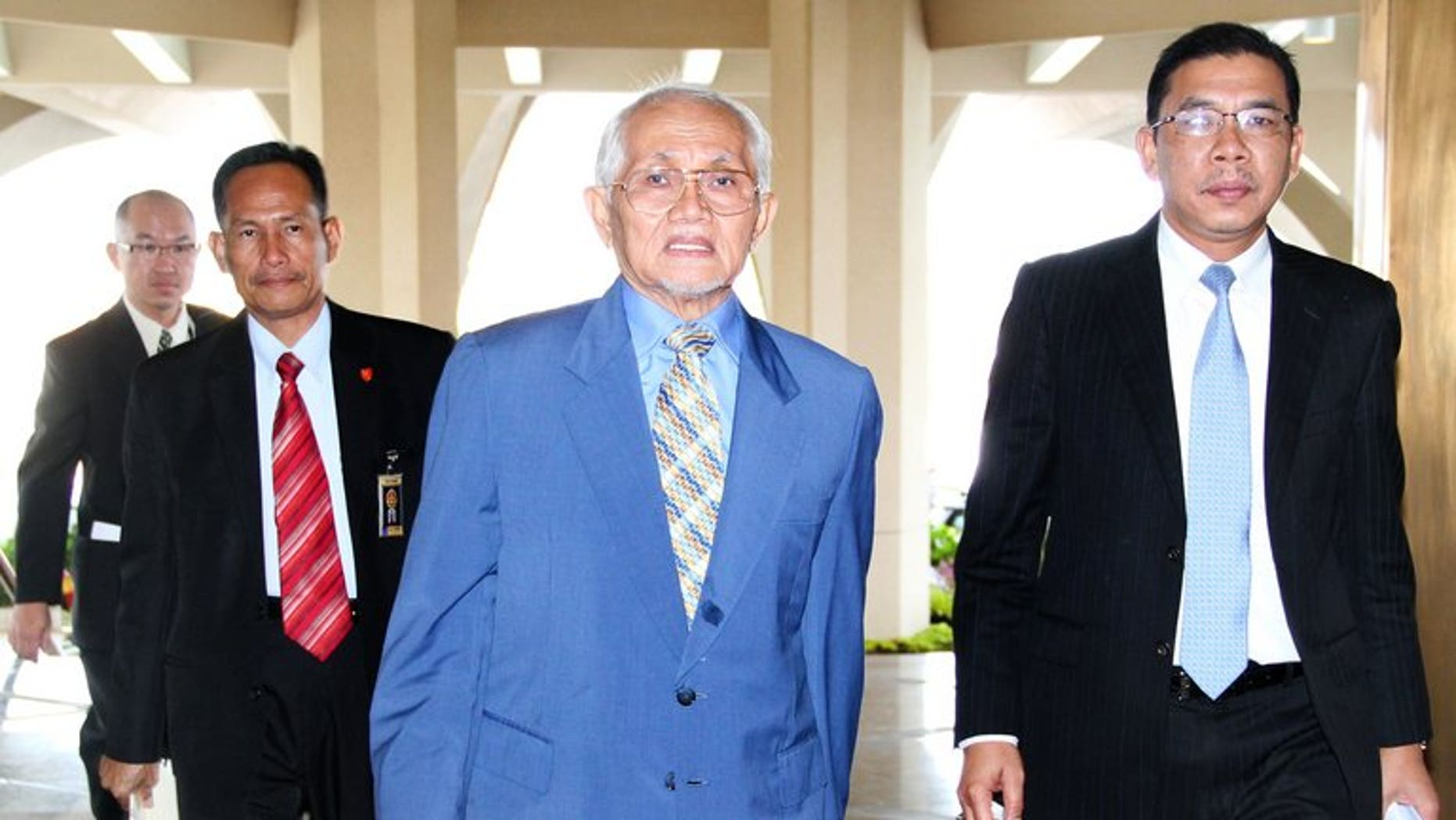 Sarawak chief minister Taib Mahmud (C) arrives at the State Legislative Assembly in Kuching, May 21, 2013. The activist sister-in-law of former British prime minister Gordon Brown says she was deported Sarawak whose powerful leader is widely accused of massive corruption.