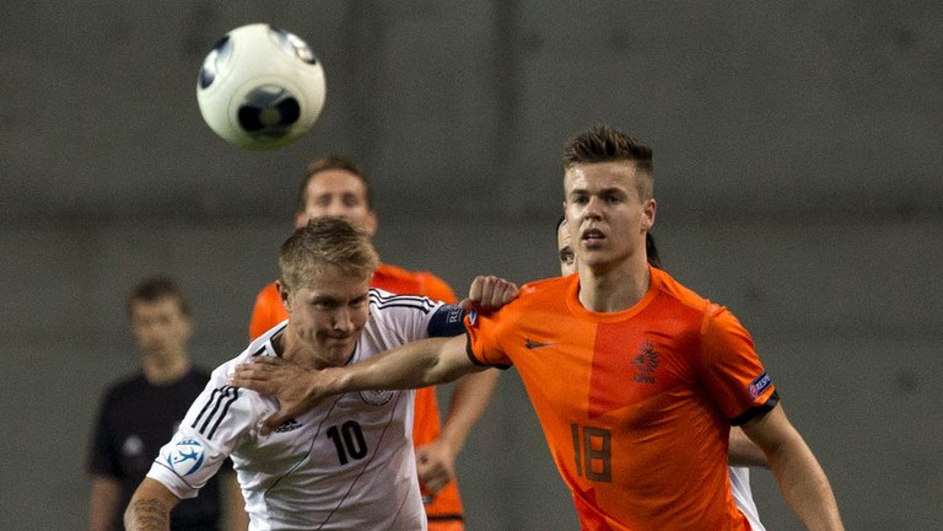 Germany's midfielder Lewis Holtby challenges Netherlands' midfielder Marco van Ginkel (right) during a 2013 UEFA U-21 Championship match at HaMoshava Stadium in Petah Tikva, north of Tel Aviv, on June 6, 2013. Chelsea have struck a deal to sign Van Ginkel from Vitesse Arnhem.