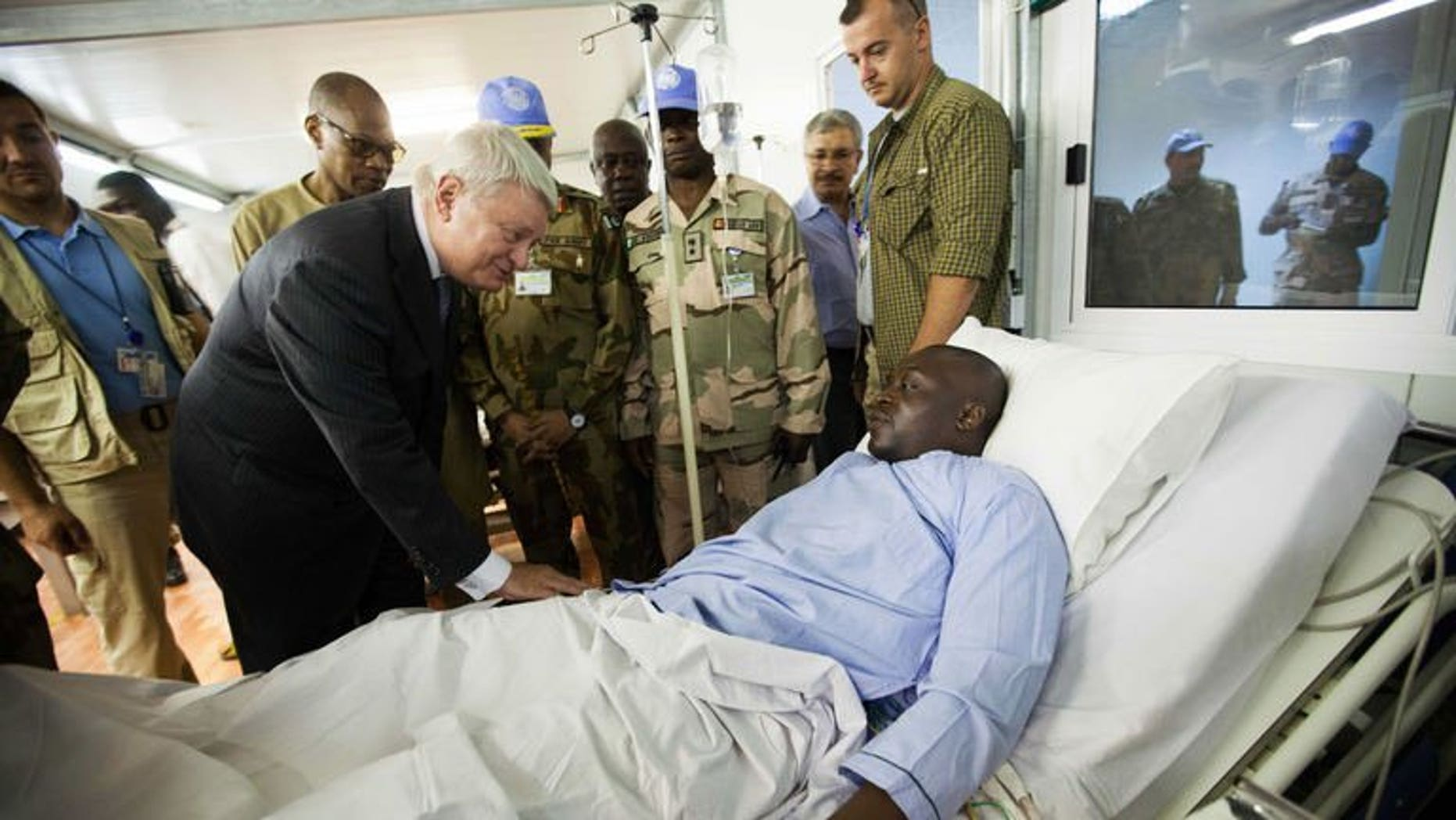 A photo released by UNAMID shows UN peacekeeping chief Herv?? Ladsous, meeting injured peacekeepers in Nyala, South Darfur, on July 4, 2013. An aid worker has been killed during fighting in the largest city of Sudan's troubled Darfur region, a humanitarian source says.