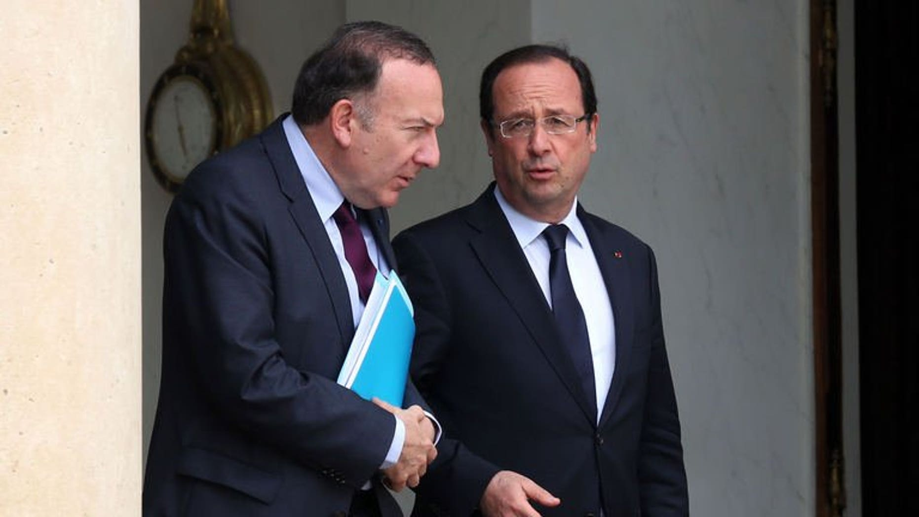 New French employers' association chief Pierre Gattaz (left) talks with French President Francois Hollande as they leave the Elysee presidential palace in Paris, on July 4, 2013. Hollande has arrived in Tunisia, birthplace of the Arab Spring uprisings that is battling political instability and ruled by an Islamist-led government, for talks expected to be dominated by events rocking Egypt.