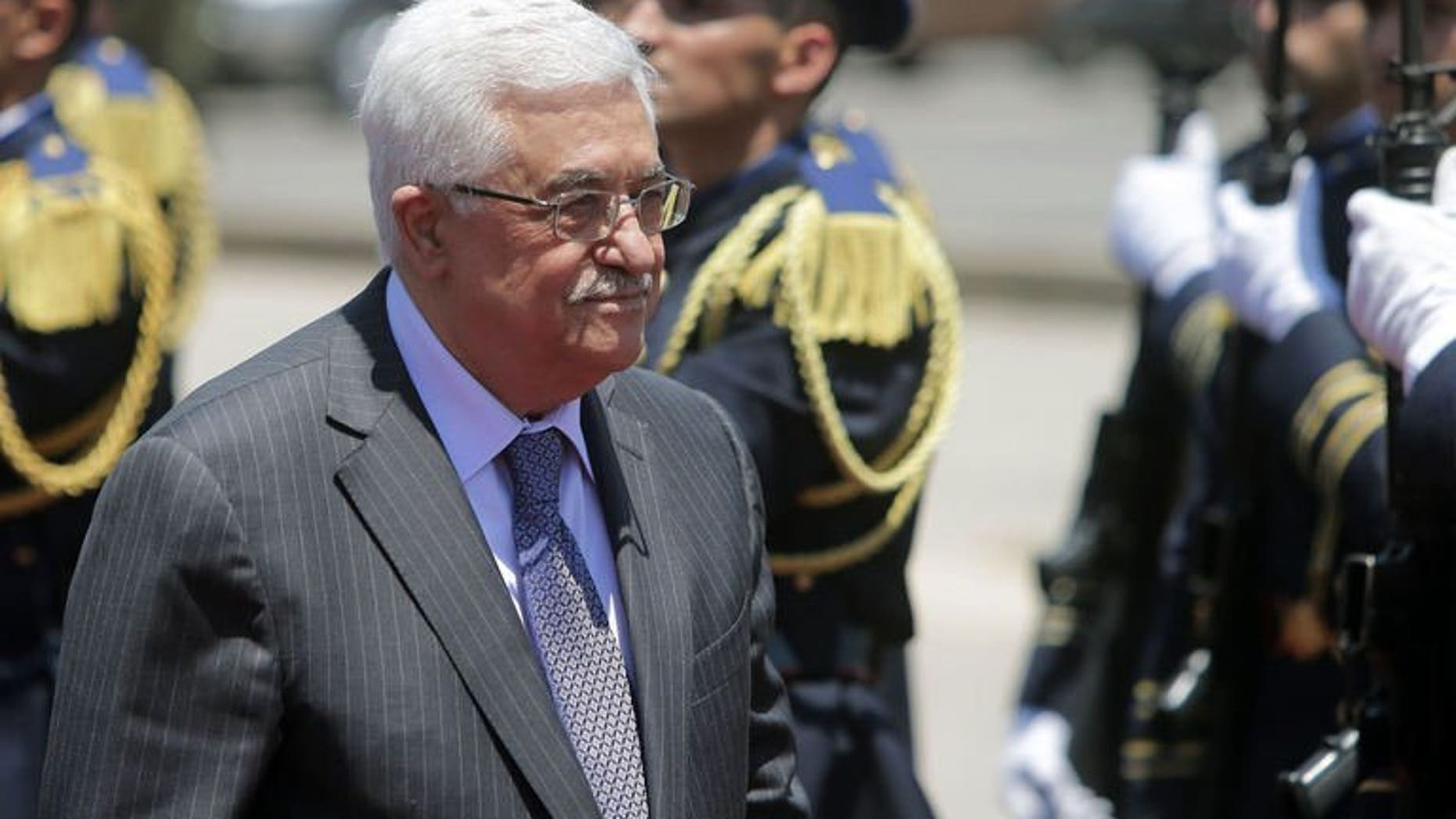 Palestinian president Mahmud Abbas reviews the guard of honour as he arrives in Beirut, on July 4, 2013. Abbas has congratulated Adly Mansour on his appointment as Egypt's interim president a day after Mohamed Morsi was overthrown by the Egyptian army.