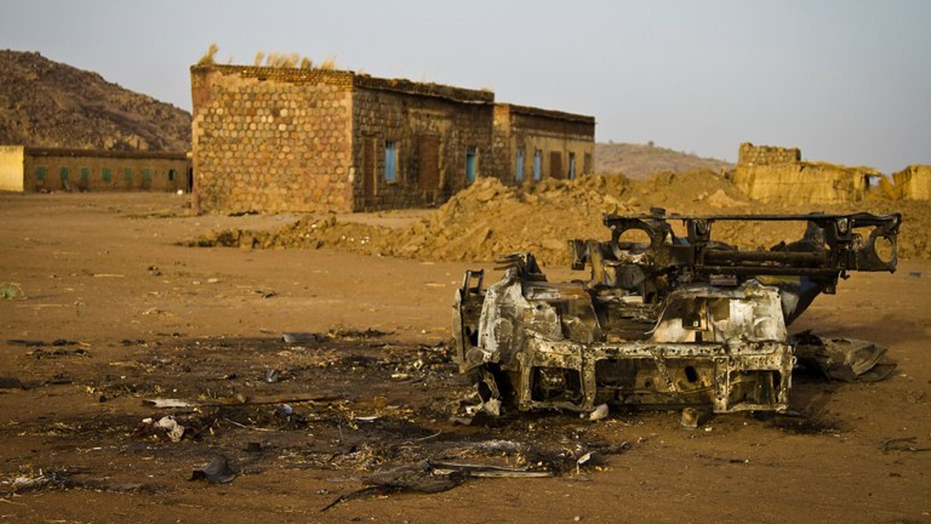 The shell of a vehicle that was hit by a bomb in the abandoned village of Trogi during fighting in South Kordofan, Sudan, is pictured on April 3, 2012. An advance party of UN troops who will support the monitoring of a buffer zone along the disputed Sudan-South Sudan border should arrive by August, the top UN peacekeeper said on Thursday.