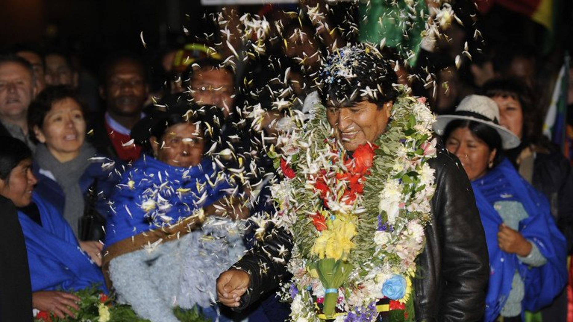 Bolivian President Evo Morales is greeted upon arrival at El Alto Airport late on July 3, 2013 in La Paz. Leftist Latin American leaders gathered in Bolivia on Thursday to back Morales, fuming after some European nations temporarily refused his plane access to their airspace amid suspicions US fugitive Edward Snowden was aboard.