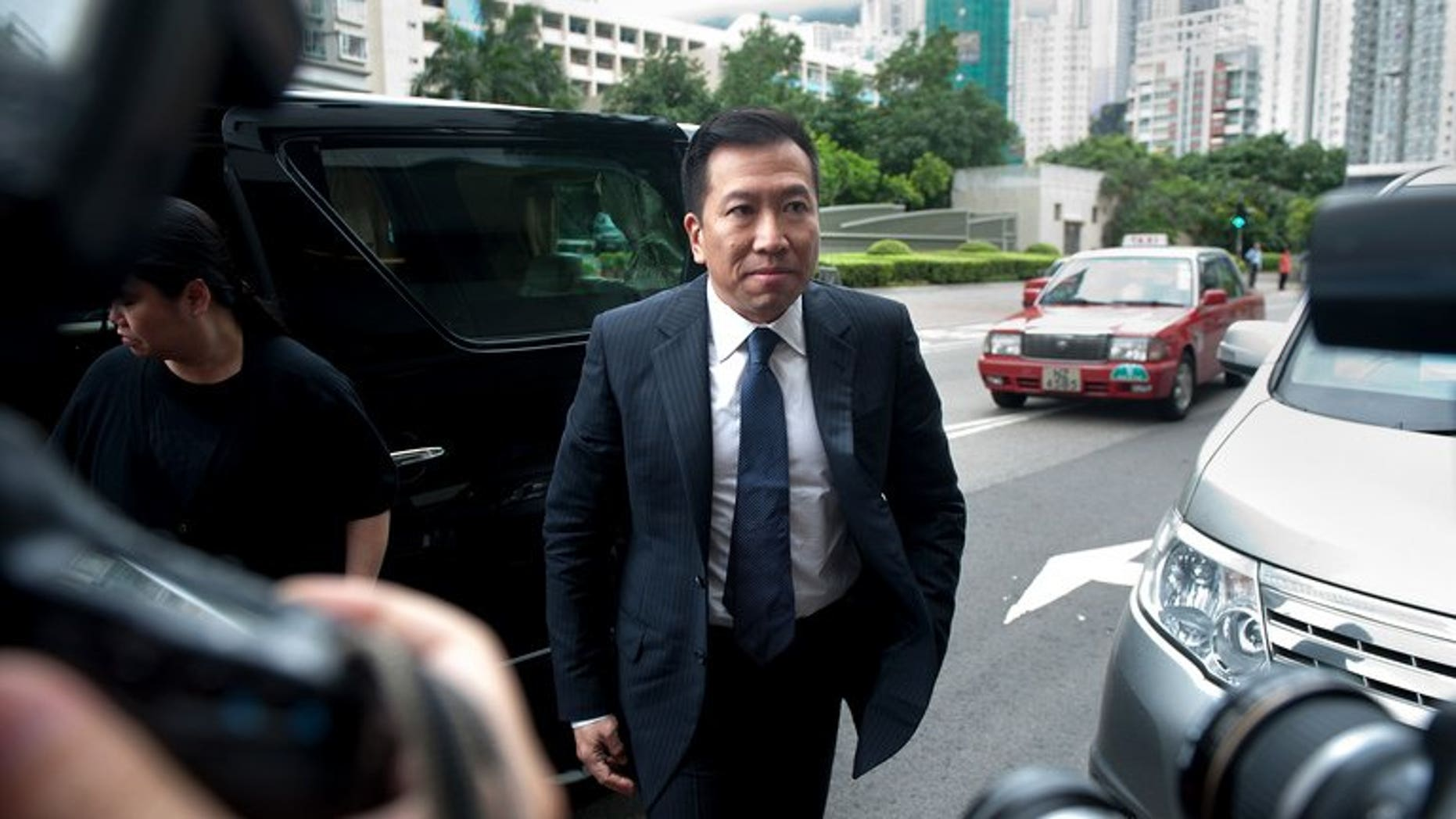 Former Feng shui master Tony Chan Chun-chuen arrives at the Eastern Court in Hong Kong on May 17, 2012. A Hong Kong court has sentenced Chan who claimed to be the lover of late billionaire Nina Wang to 12 years in jail after finding him guilty of forging her will.