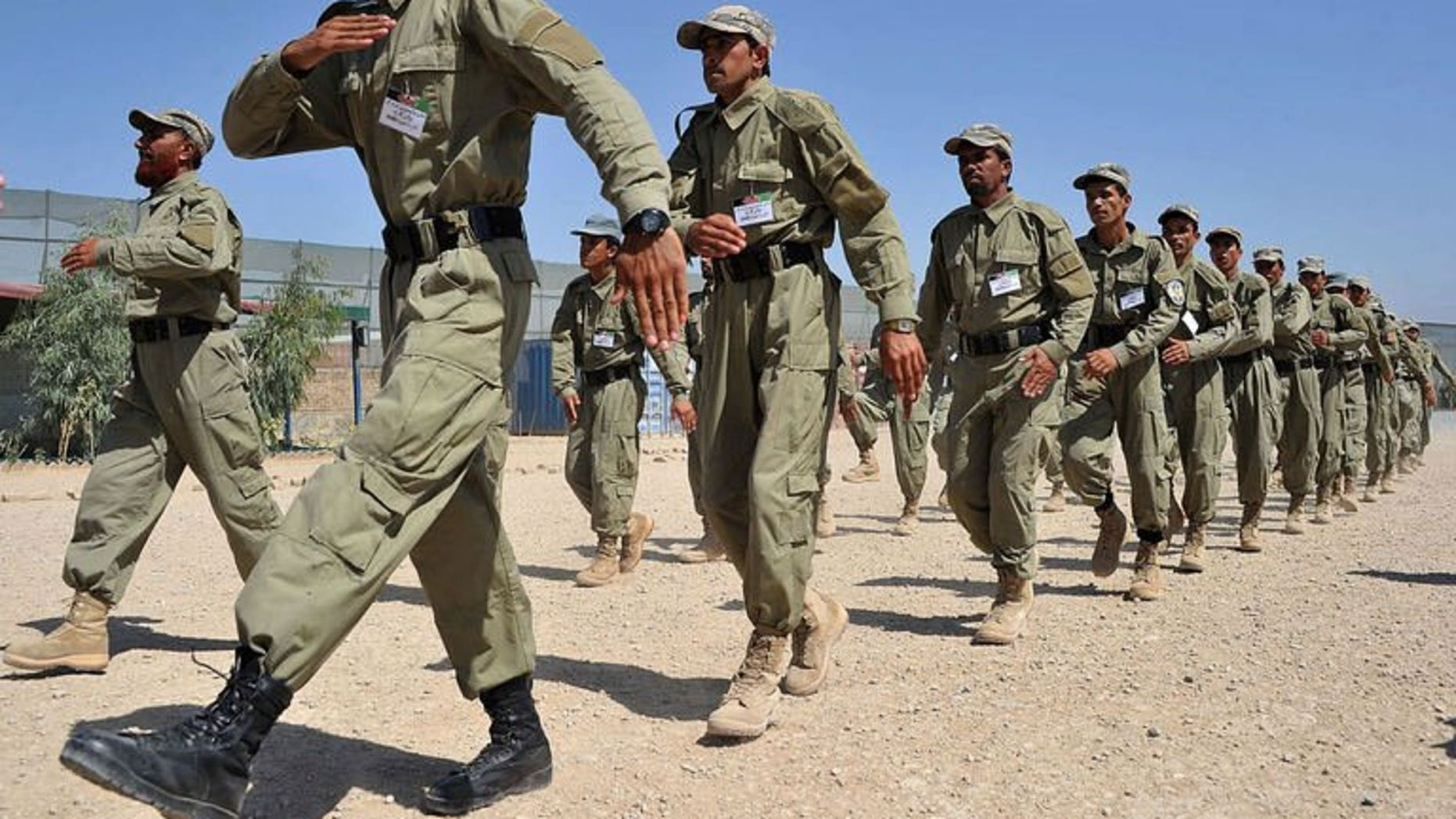 Afghan police march during a graduation ceremony at a police training centre on the outskirts of Jalalabad on July 4, 2013. A suicide bomber killed 12 policemen in the southern Afghan province of Uruzgan on Friday when he blew himself up inside a police station as officers ate lunch in a dining hall, officials said.
