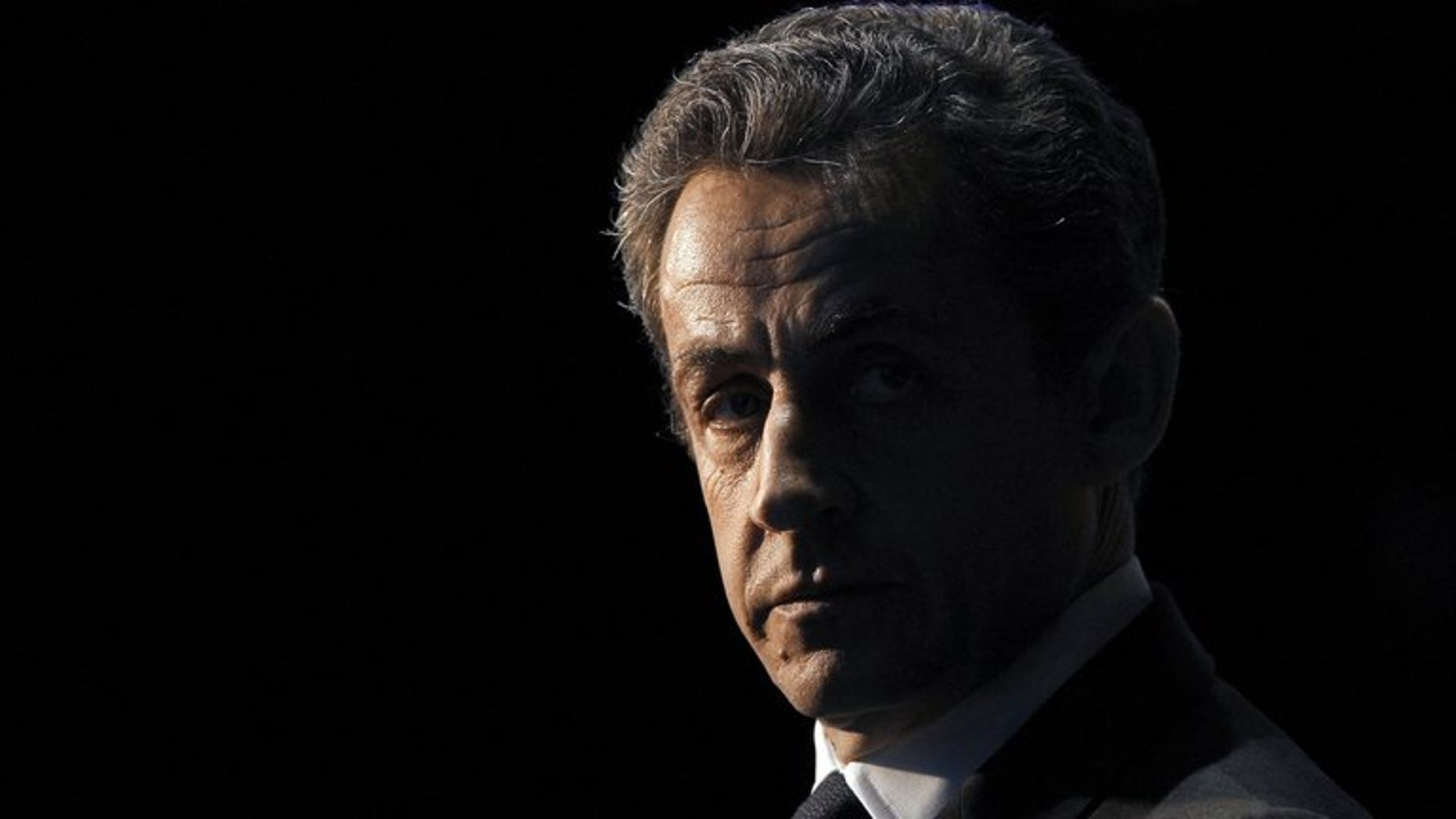 France???s then-president Nicolas Sarkozy waits to take part in a TV show in Paris on April 10, 2012. Sarkozy made a dramatic return to the French political scene on Friday, slamming a decision to deny his right-wing UMP party millions of euros in campaign reimbursements and issuing a call to arms to his supporters.