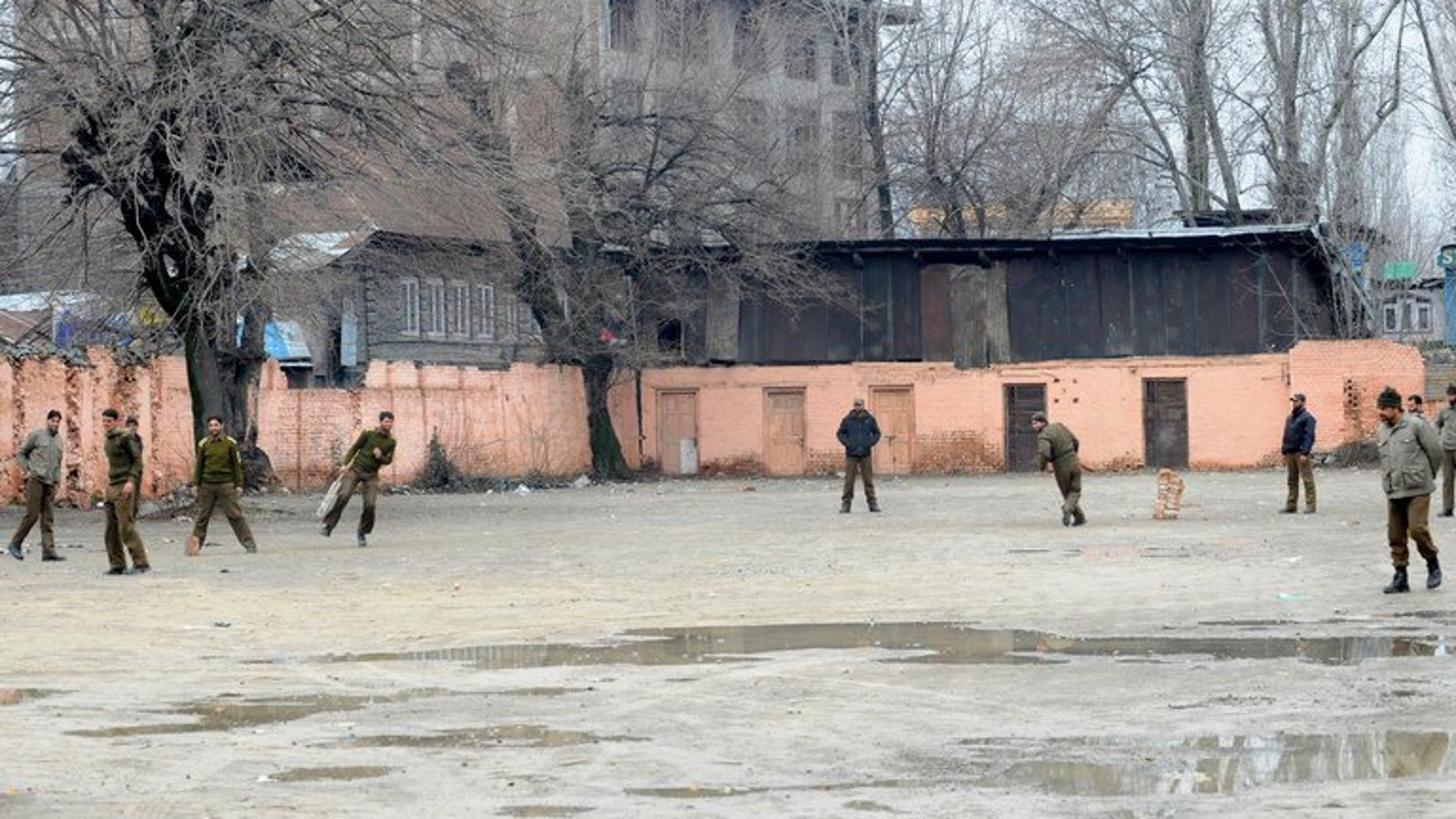 Policemen play cricket during a strike in Srinagar, Kashmir in February. Parvez Rasool on Friday became the first Kashmiri cricketer to be selected for India after he was named for a limited-overs series against Zimbabwe later this month.