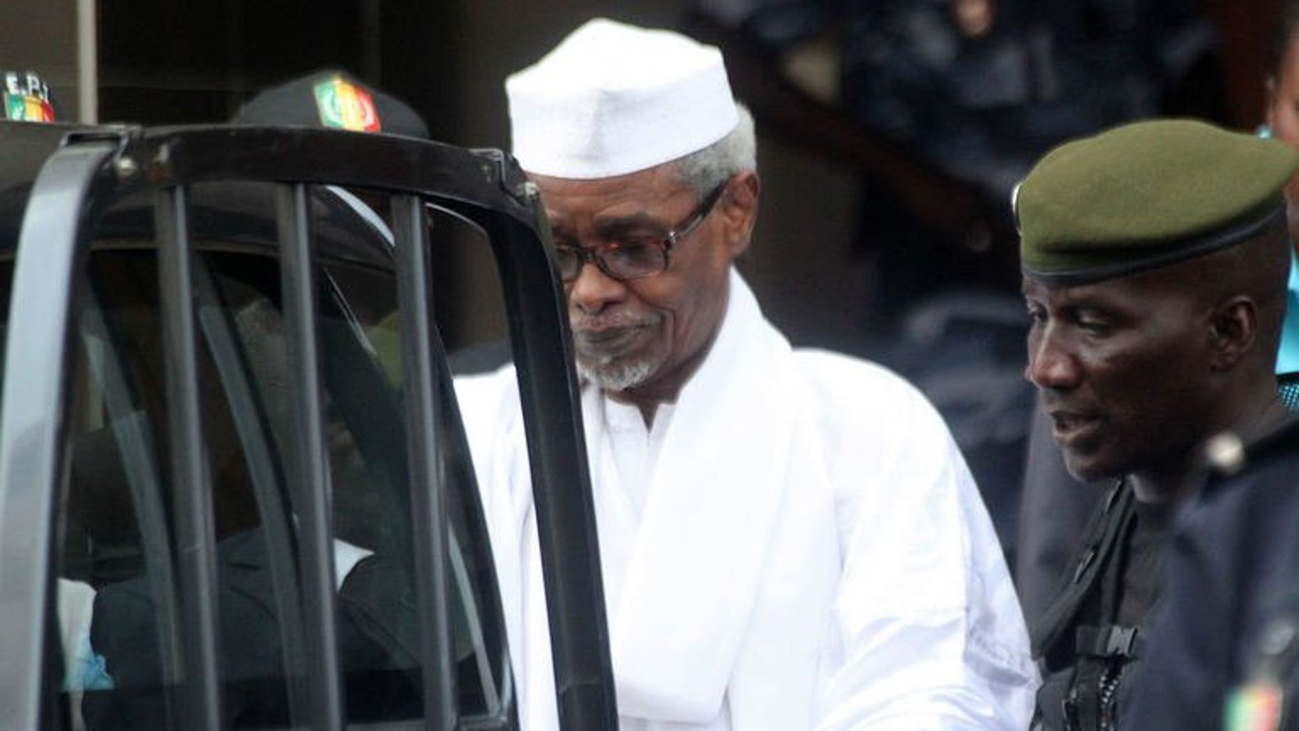 Former Chadian dictator Hissene Habre is escorted by military officers after being heard by judge on July 2, 2013 in Dakar. Thousands of people paraded the streets of Chad's capital N'Djamena on Friday to celebrate the arrest of former dictator Hissene Habre, held since Sunday in the Senegalese capital of Dakar.