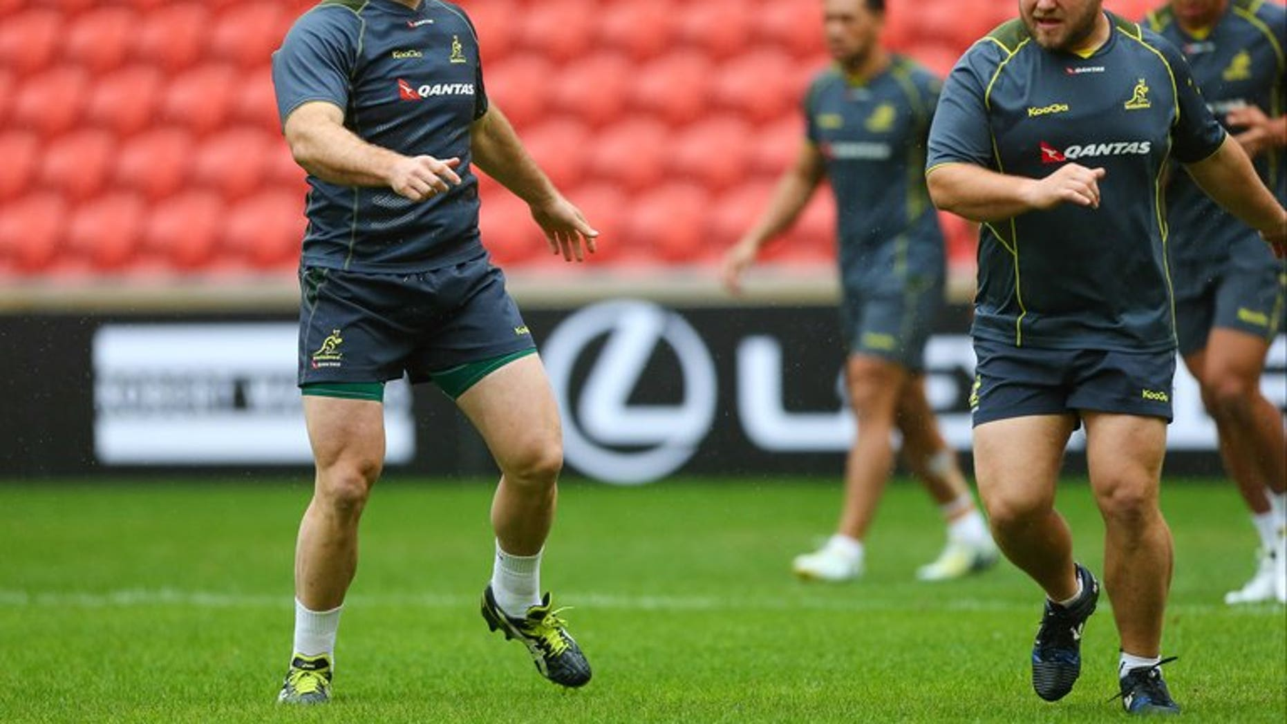 Australian rugby union players Stephen Moore (L) and Benn Robinson (R) take part in the captain's run at Suncorp Stadium in Brisbane on June 21, 2013. Moore on Friday said the referee and dominating the scrum held the key to victory in Saturday's series decider against the British and Irish Lions.