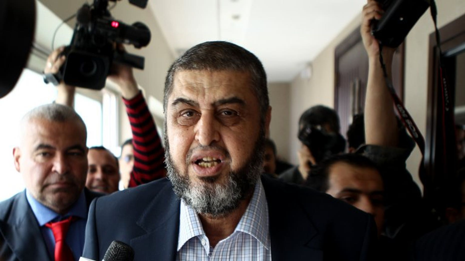 Khairat el-Shater leaves following a press conference in Cairo on April 9, 2012. Egyptian police arrested Shater, widely seen as the most influential Islamist politician behind deposed president Mohamed Morsi, an interior ministry general told AFP.