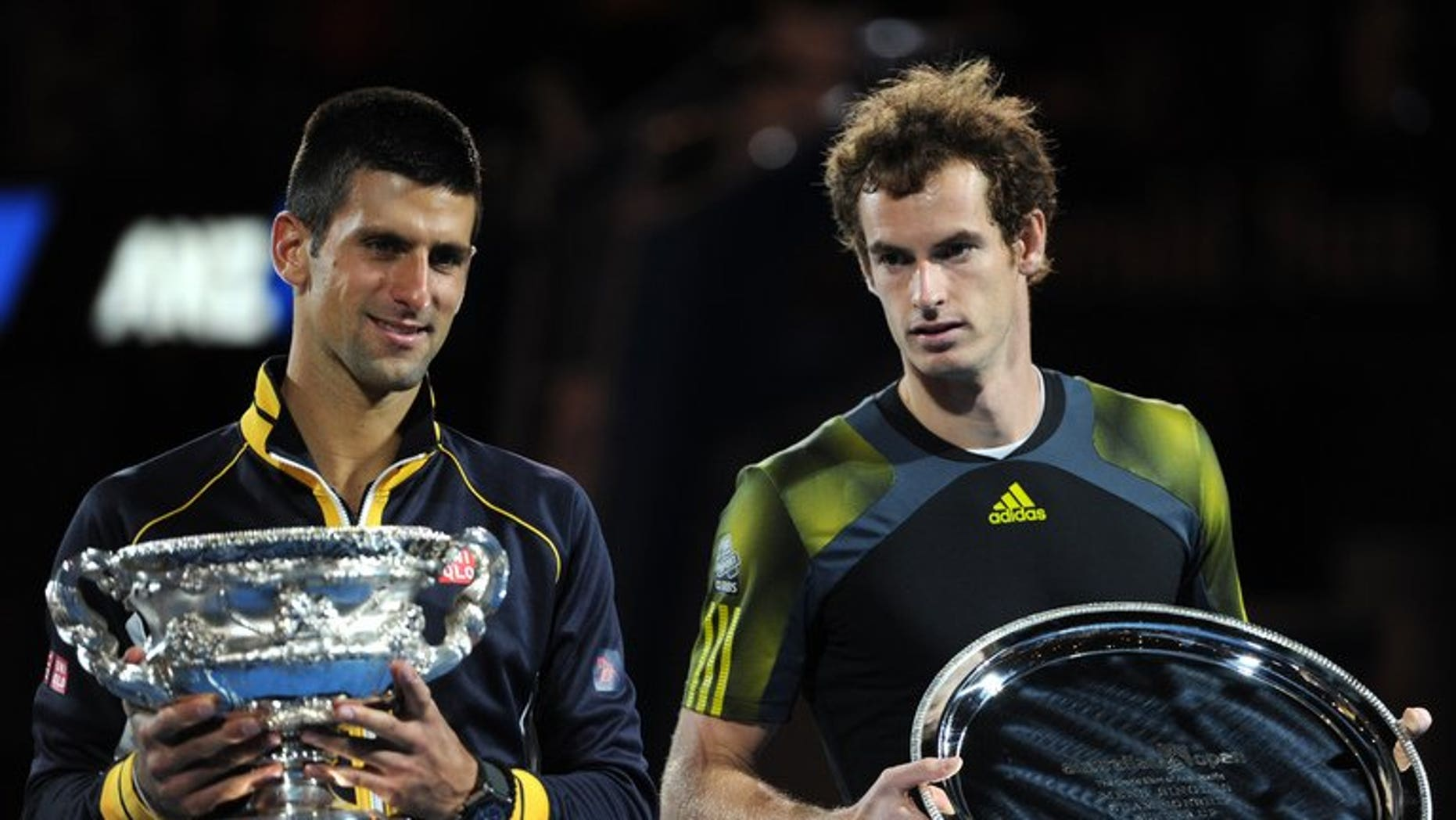 Noval Djokovic (left) and Andy Murray after the Australian Open final in Melbourne in January. Penpix of Novak Djokovic and Andy Murray who contest the Wimbledon men's final at the All England Club on Sunday.