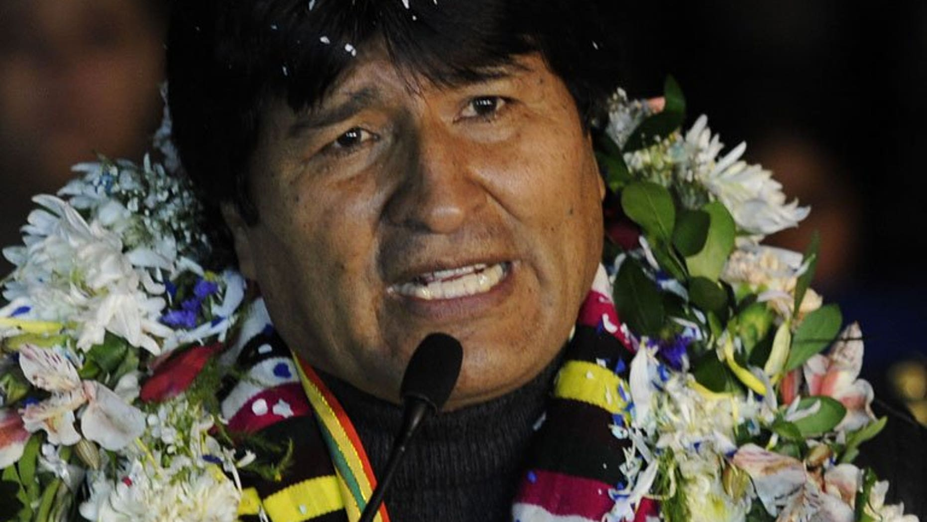 Evo Morales speaks to journalists at El Alto Airport late July 3, 2013 in La Paz. The Bolivian President says he would grant asylum to Edward Snowden, if the fugitive US leaker, who is holed up in an airport in Moscow, requests it.