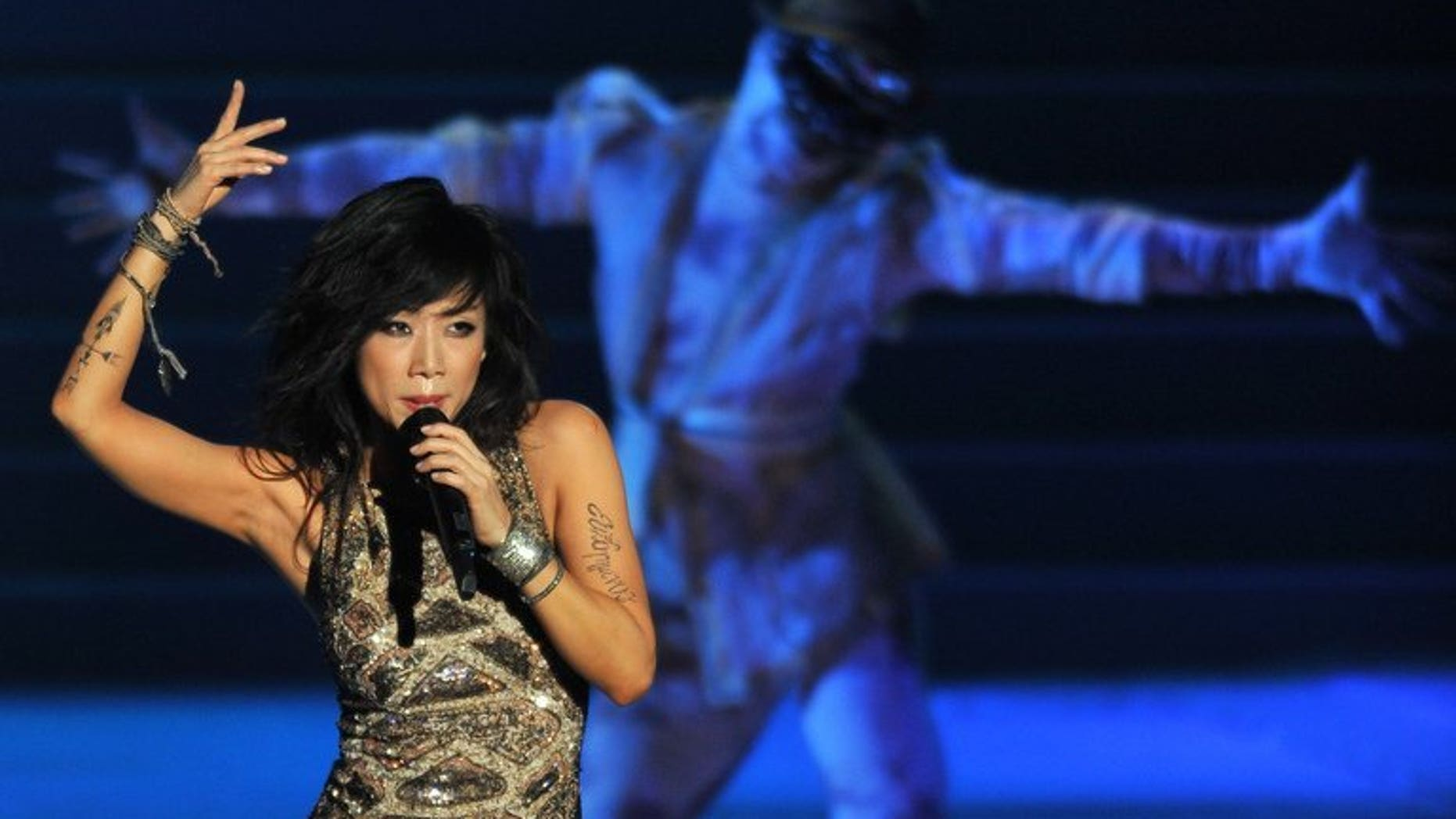 Pop musician Sandy Lam performs on stage during her concert in Kuala Lumpur on July 28, 2012. Lam won top honours at the Golden Melody Awards for Asia's best Mandarin chart music in Taipei on Saturday.