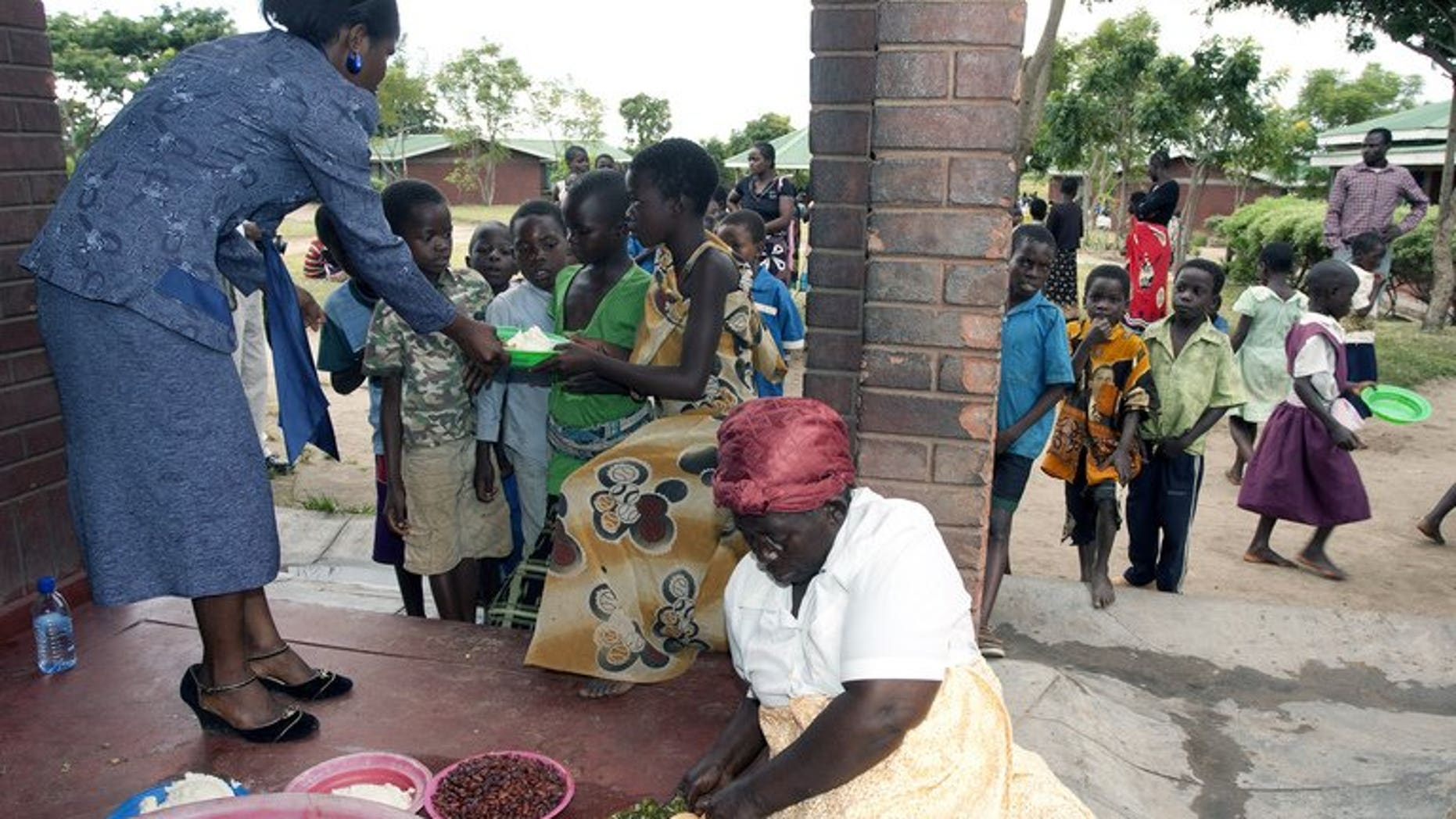 Children receive food at Mphandula Childcare Centre in Namitete on April 5, 2013. Malawi's runaway population growth has put pressure on scarce resources and so hampered development in the impoverished southern African nation, President Joyce Banda said Saturday.
