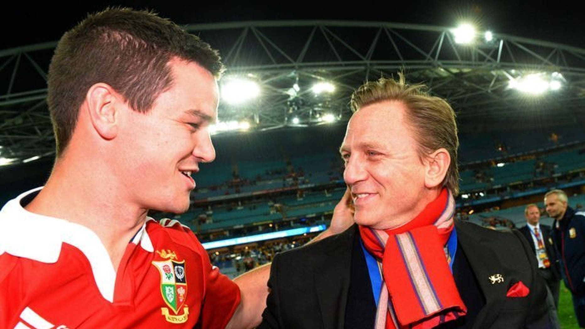 British and Irish Lions flyhalf Jonathan Sexton (L) celebrates with British actor Daniel Craig (R) after the Lions defeat the Australian Wallabies in the third rugby Test match played in Sydney on July 6, 2013. Craig brought a little stardust to the celebrations on Saturday.