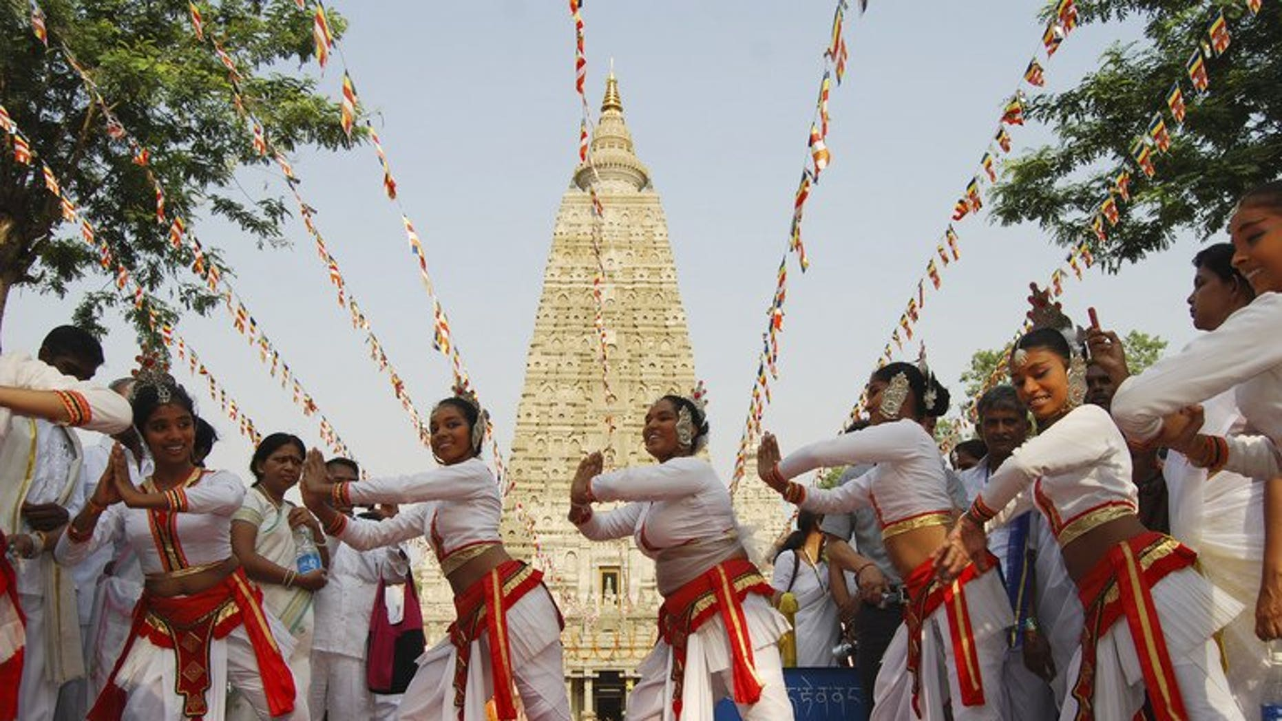 This file photo shows traditional dancers performing in front of Mahabodhi Temple in Bodhgaya, on May 17, 2011. Police reported multiple low-intensity blasts at the temple complex on Sunday, saying two people had been wounded but the temple was safe.