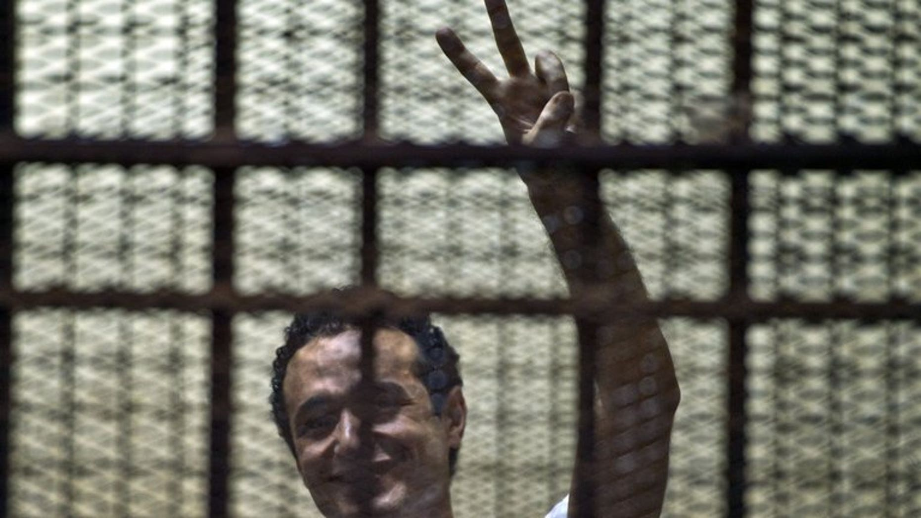 Ahmed Douma stands in the dock during his trial in Cairo on June 3. An Egyptian court on Sunday acquitted Douma and 11 other activists opposed to Mohamed Morsi of charges they incited violence against members of his Muslim Brotherhood, a judicial source said.