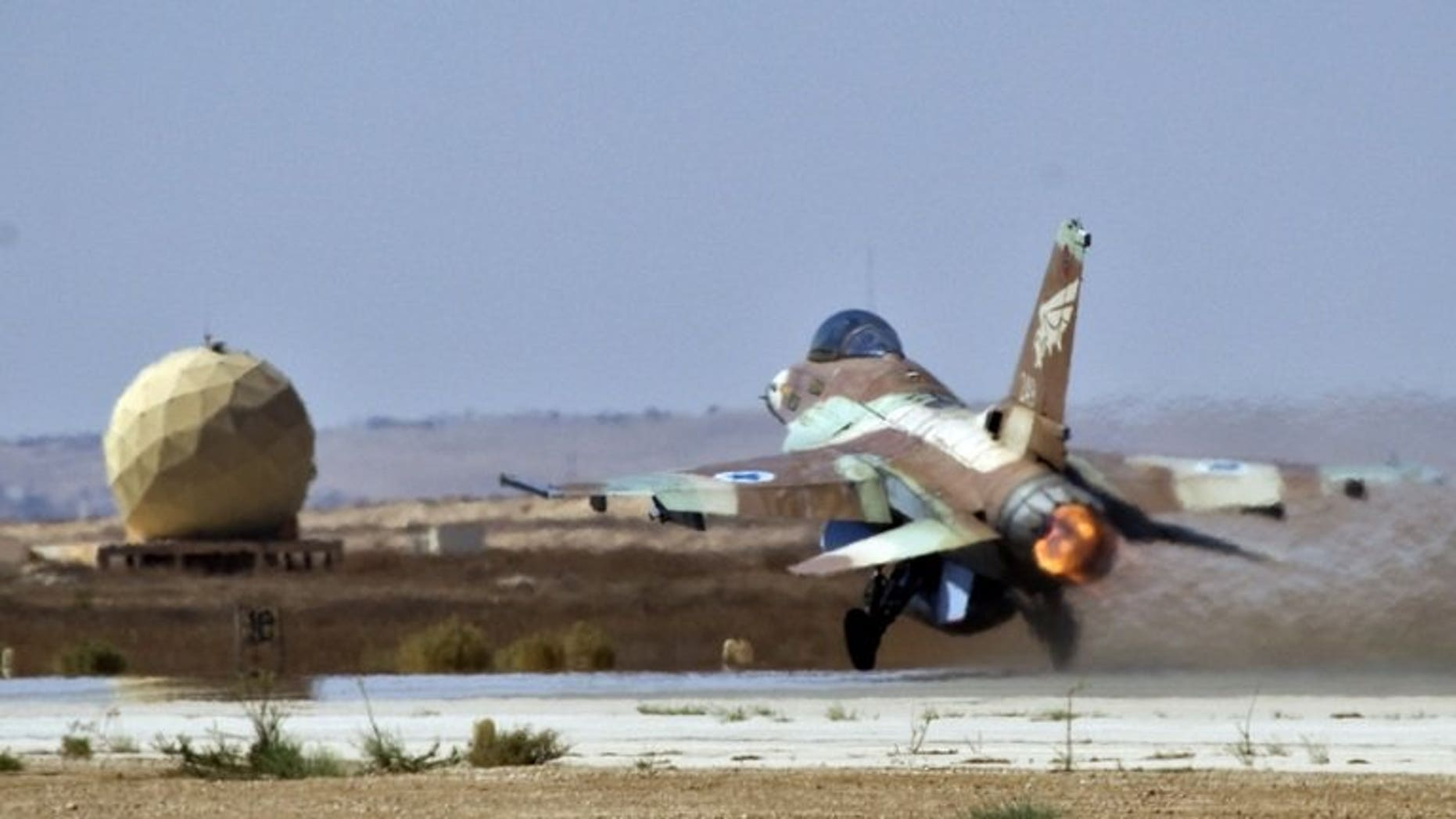 An Israeli F-16 fighter jet takes off at the Nevatim air force base near Beersheva on October 6, 2010. An Israeli warplane has crashed into the Mediterranean Sea following a malfunction although both crew members were rescued unharmed, a military spokesman tells AFP.