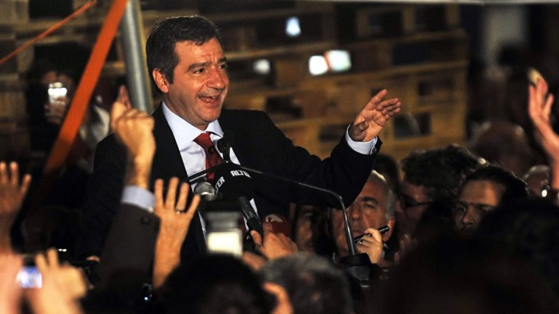 Athens Mayor George Kaminis talks to a crowd late on November 14, 2010. Kaminis was assaulted on Sunday by suspected staff unionists, his office said, amid protests over job cuts tied to Greece's bailout rescue.