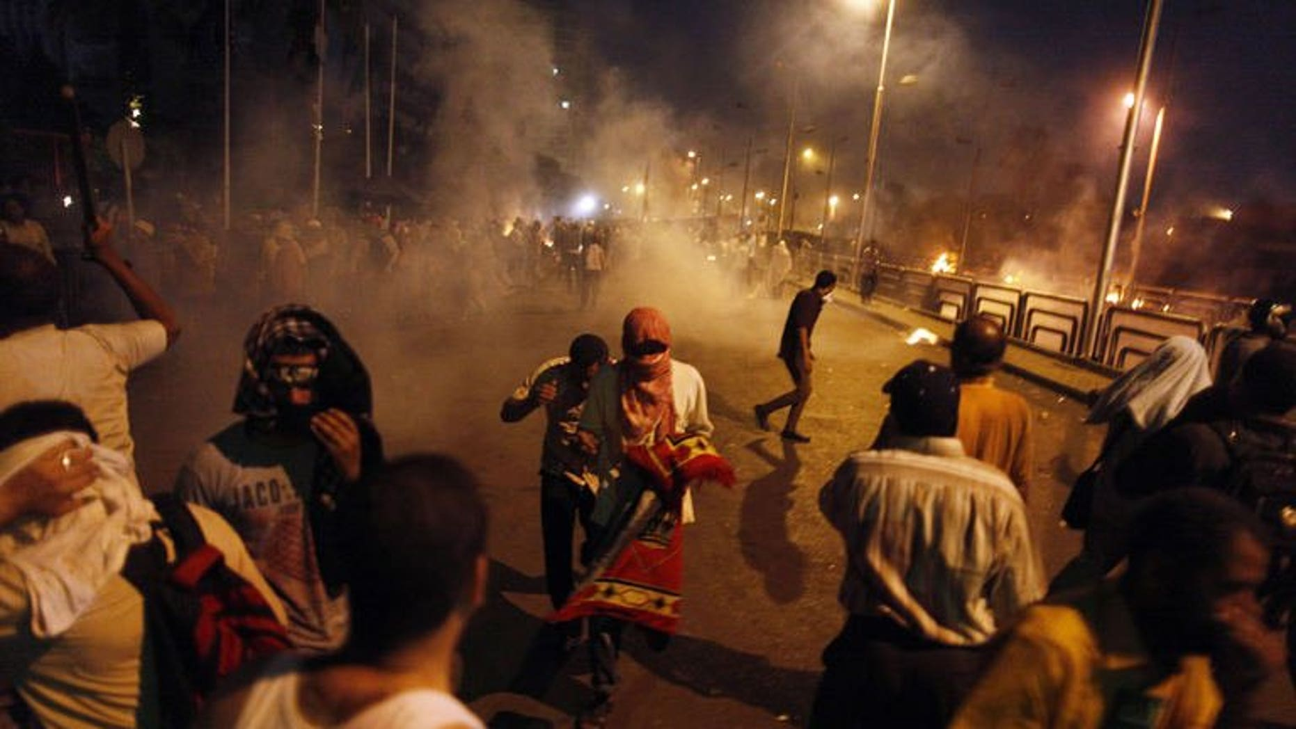 Egyptian supporters of the Muslim Brotherhood clash with police outside the elite Republican Guards base in Cairo early on July 8, 2013. The Brotherhood said on Monday that 35 supporters of ousted president Mohamed Morsi were killed at dawn when security forces opened fire on them as they were praying.