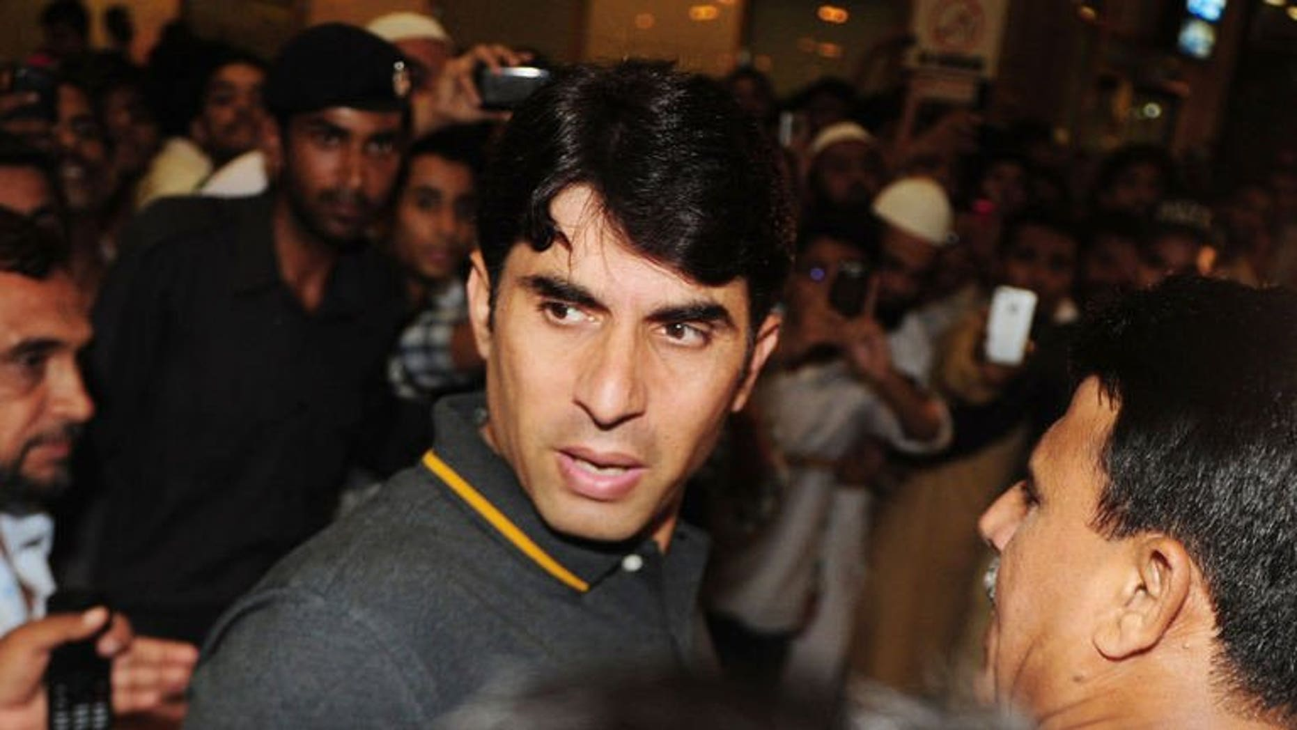 Pakistan ODI cricket captain Misbah-ul Haq (C) arrives at Karachi International Airport before his departure to the Caribbean, in Karachi on July 7, 2013. Pakistan's one-day squad left for the Caribbean with Misbah hoping to reverse the team's dwindling fortunes in the limited over matches.