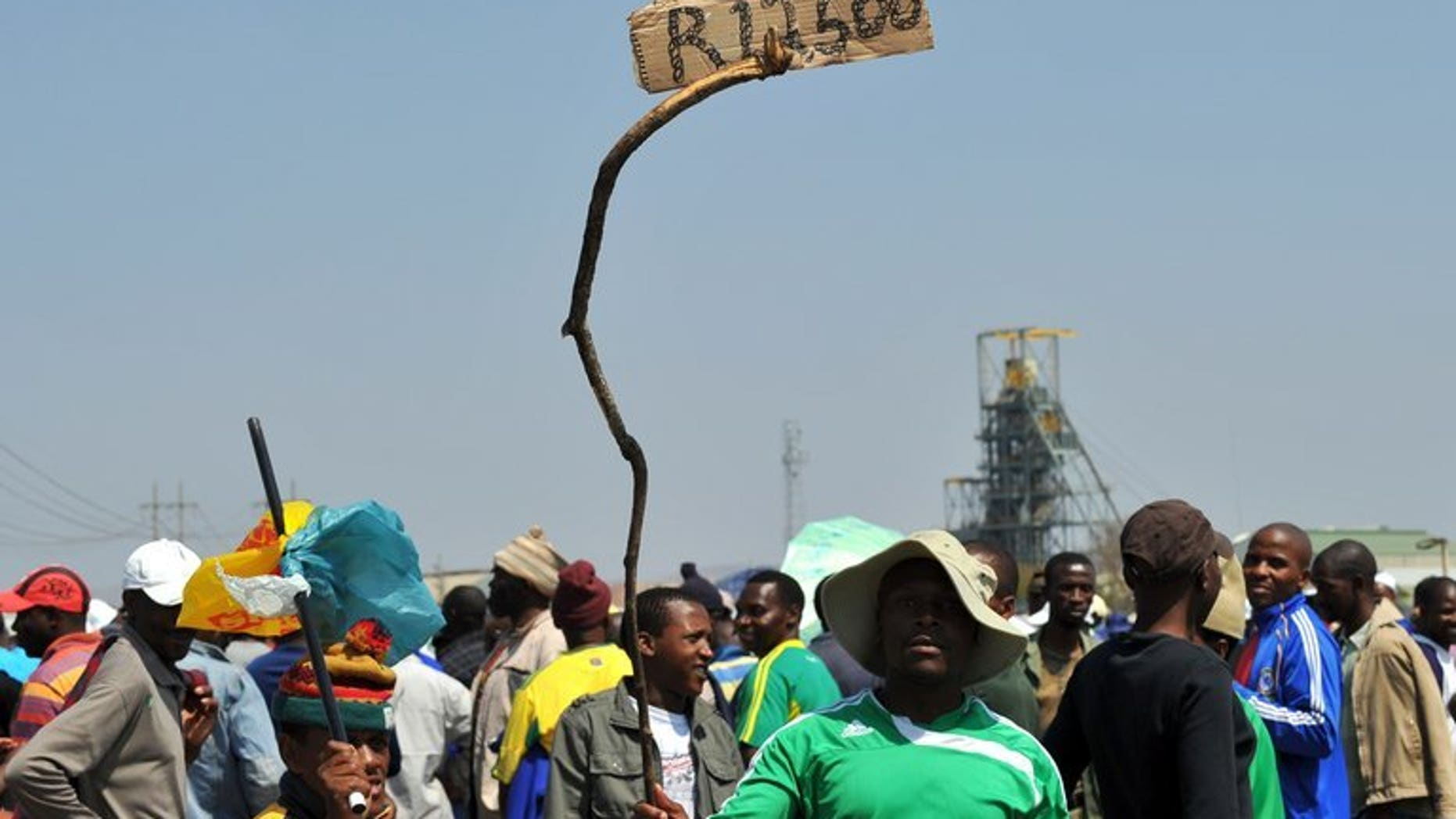 A sign in Rustenburg last September reads 12,500 rand, the wage sought by Amplats miners. Moody's rating agency on Monday warned South African banks and other lenders which issue loans without collateral face a bumpy time ahead as the economy wobbles and labour unrest continues.