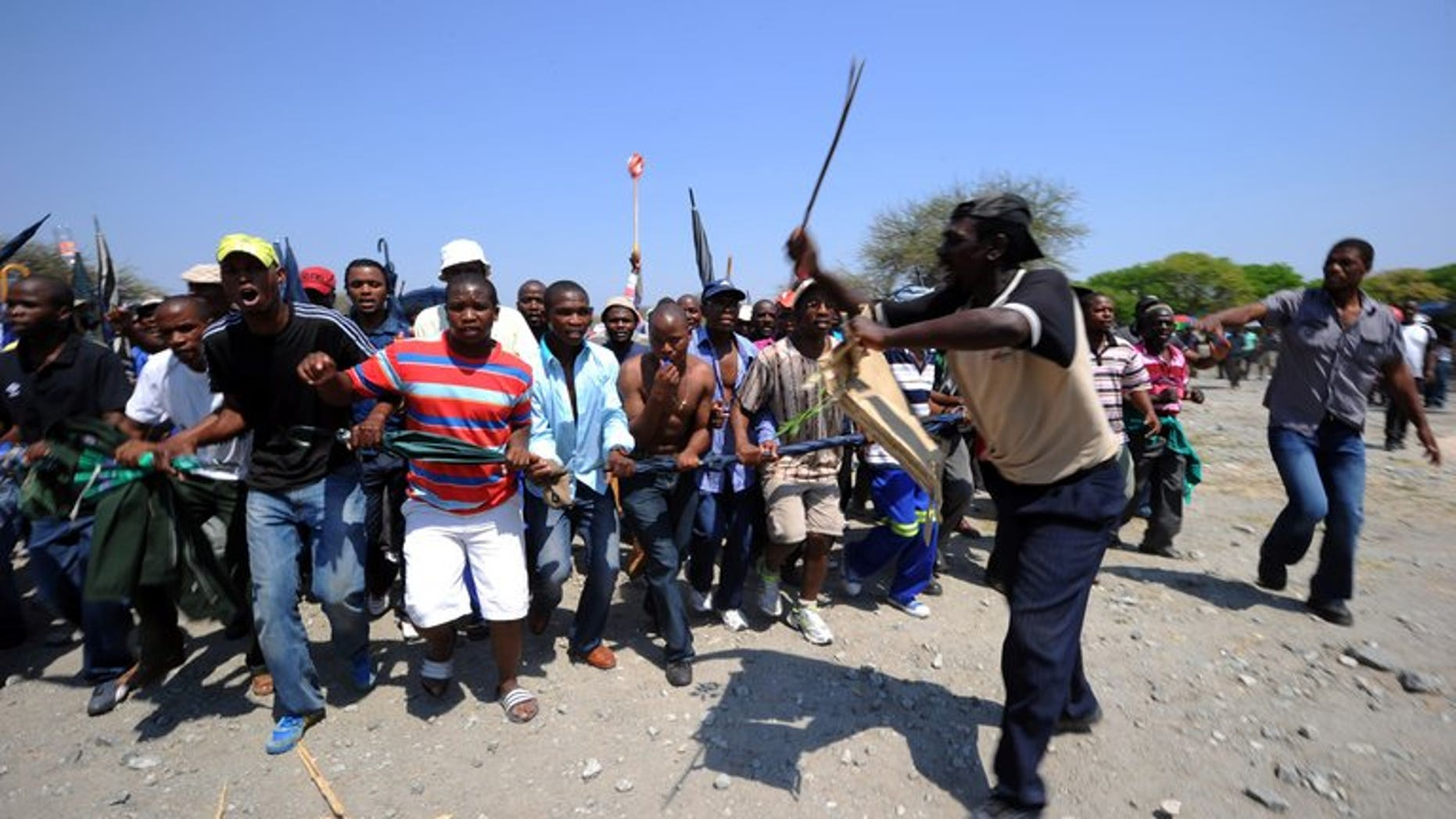 Some of 12,000 miners sacked by Amplats last year protest at Bleskop Stadium in Rustenburg last October. Some 5,600 mineworkers at the world's top platinum producer Anglo American Platinum downed tools overnight at the firm's South African operations, demanding the reinstatement of suspended union leaders, the company said Monday.
