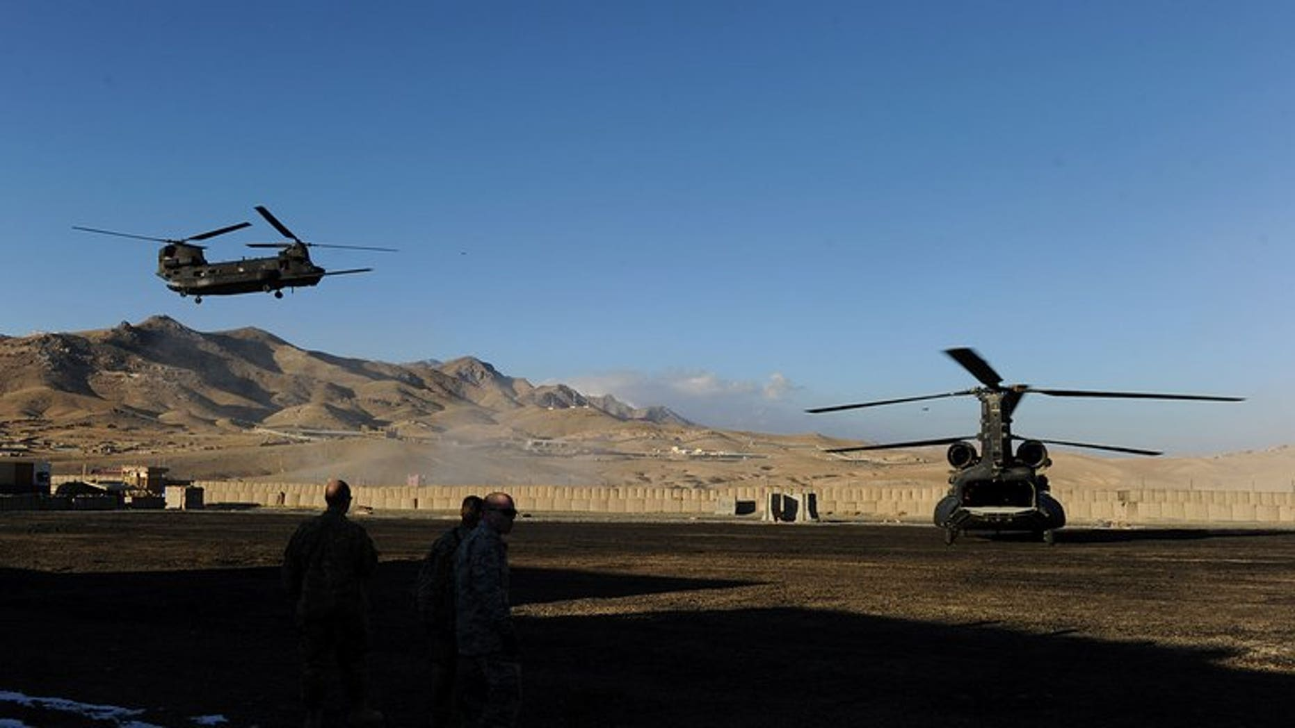 A US military helicopter prepares to land at a US base in Maidan Shar Wardak province on January 11, 2011. Afghanistan's intelligence agency is holding an Afghan-American translator on suspicion of torturing and killing civilians while working for US special forces, officials said Monday
