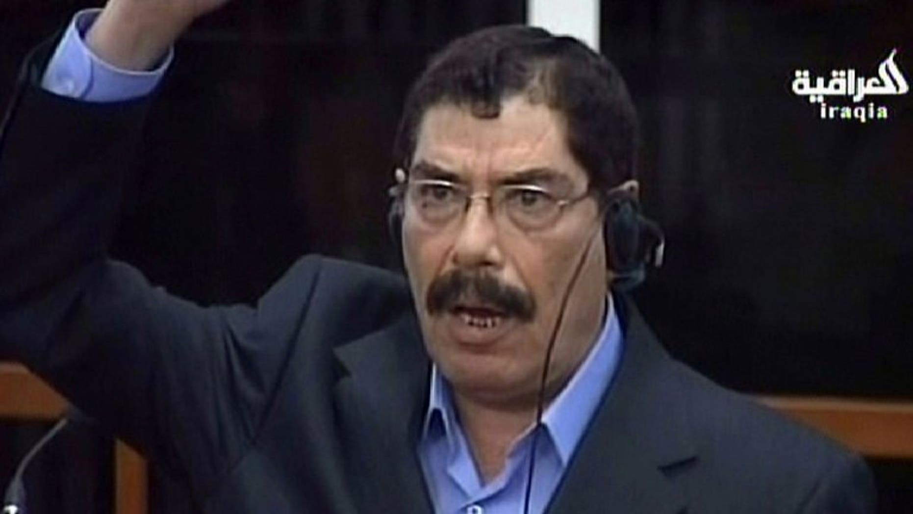 An image grab taken from the state-owned Al-Iraqiya TV shows Saddam Hussein's half-brother, former security service chief Sabawi Ibrahim al-Hassan, as the Iraqi High Tribunal sentenced him to death for crimes against humanity at the court in the Green Zone in Baghdad on March 11, 2009. Hassan died of cancer in a Baghdad hospital on Monday, the justice ministry said.