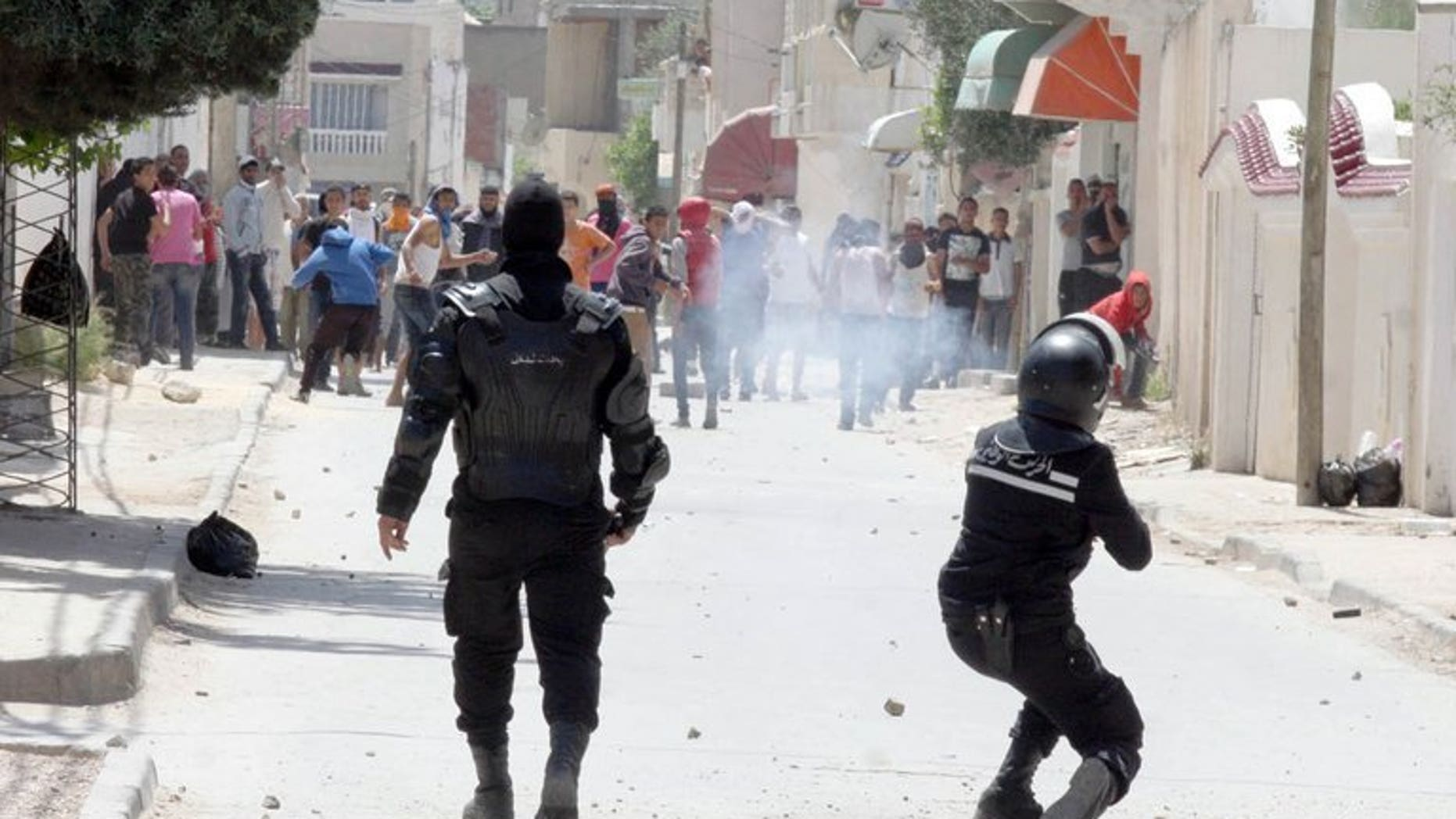 """Police clash with radical Islamists on May 19 in Ettadhamen, a poor neighbourhood west of Tunis. Tunisia's public prosecutor Monday ordered police to investigate an attack on 19 actors by Salafist Muslims, while they decided whether to charge the artists with alleged """"indecency"""", a lawyer for the drama group said."""