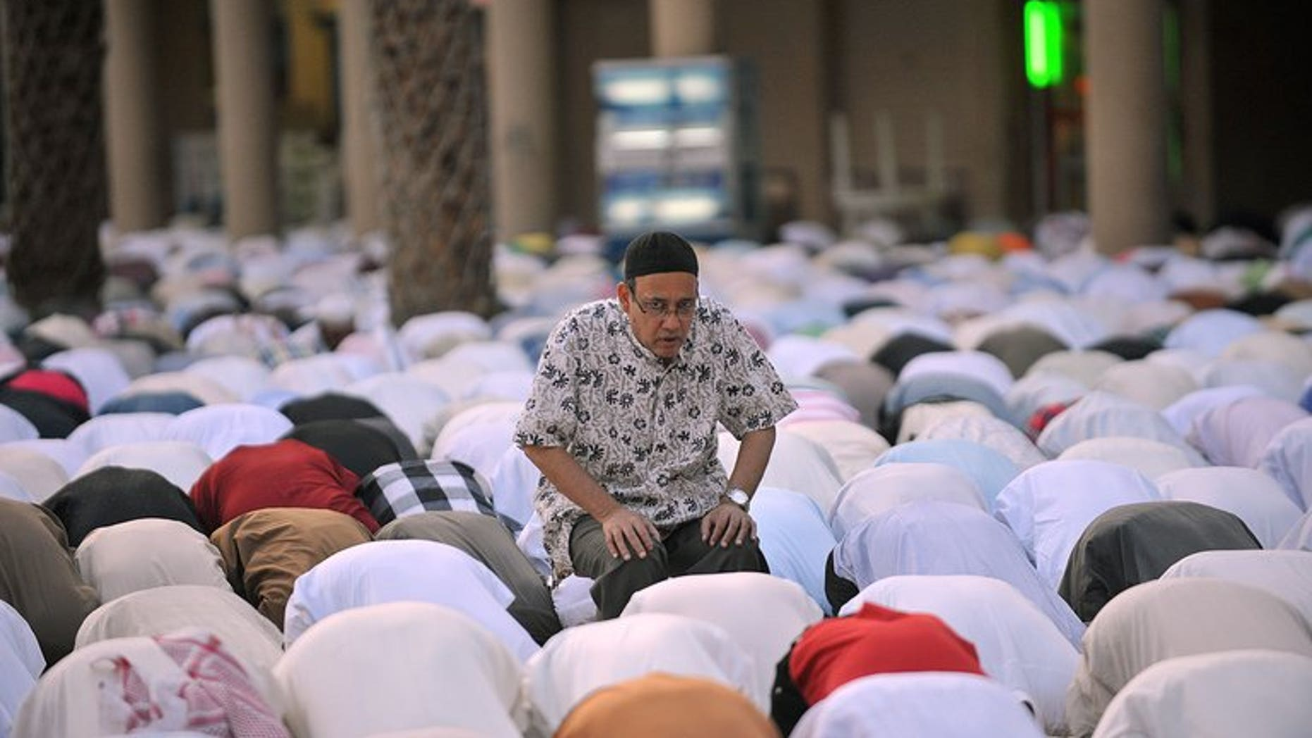 Men in Saudi Arabia pray on the first day of Eid al-Fitr in the great mosque in the old city of Riyadh, on August 19, 2012 to mark the end of the holy fasting month of Ramadan. The holiday will begin in Saudi Arabia on Wednesday, the royal cabinet announced in a statement Monday, citing the kingdom's religious authorities.