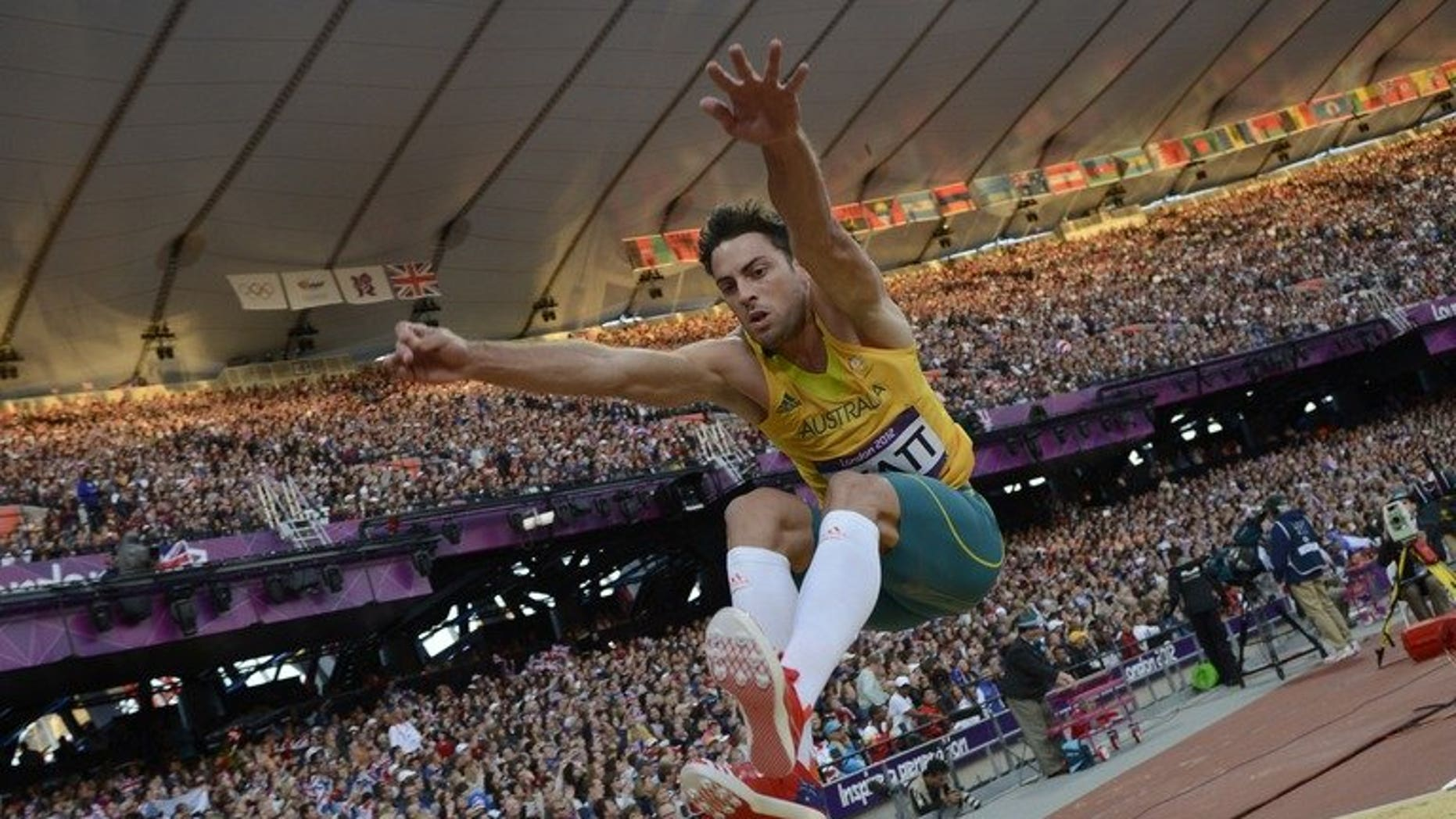 Australia's Mitchell Watt competes during the London Olympics men's long-jump qualifying rounds on August 3, 2012. He on Tuesday pulled out of the Moscow world championships after an injury-plagued build-up.