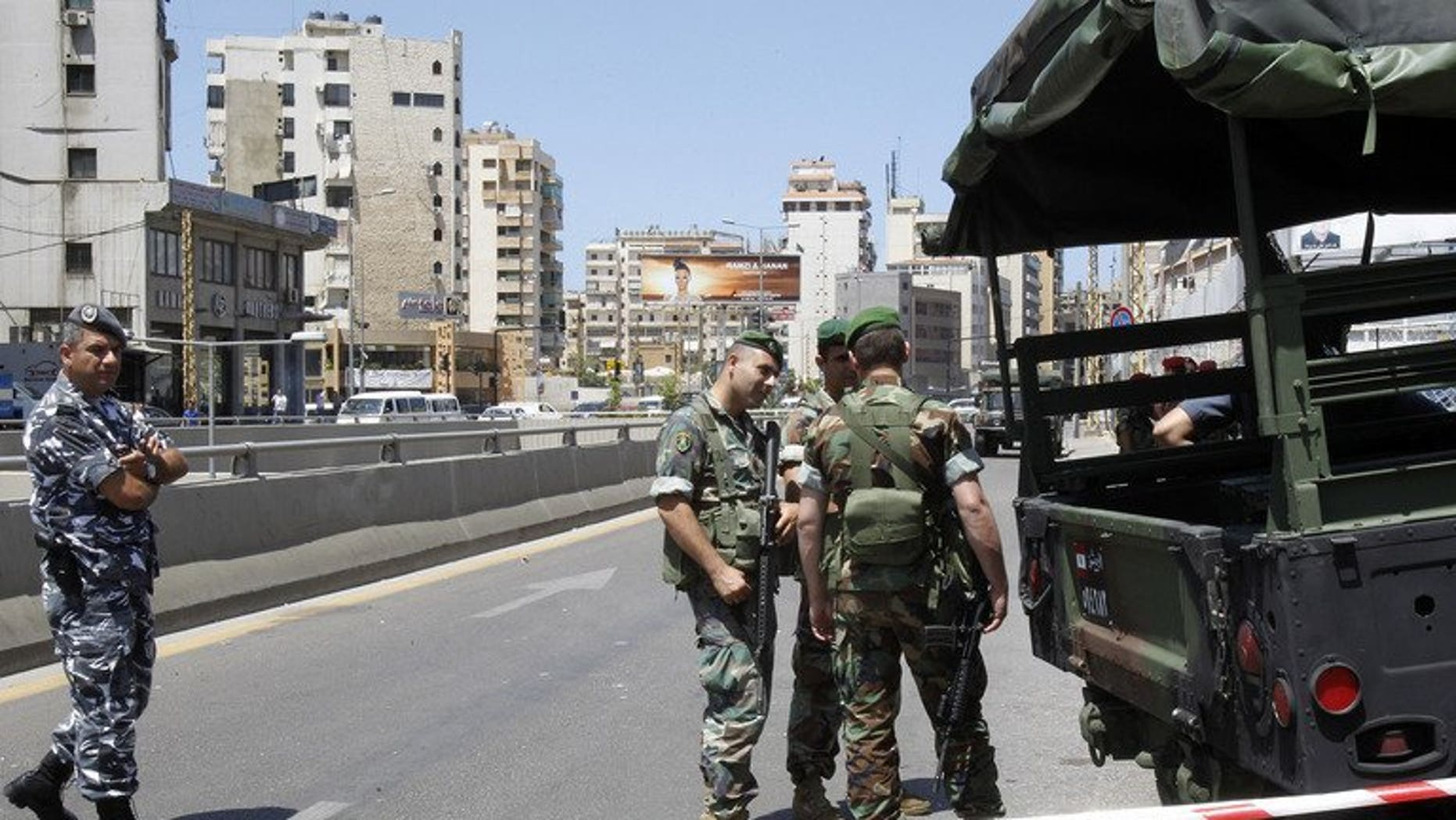 Lebanese security forces stand guard in Beirut on May 26, 2013. A car bomb on Tuesday rocked Beirut's Hezbollah stronghold in the southern suburbs, which is populated mainly by Shiite Muslims.