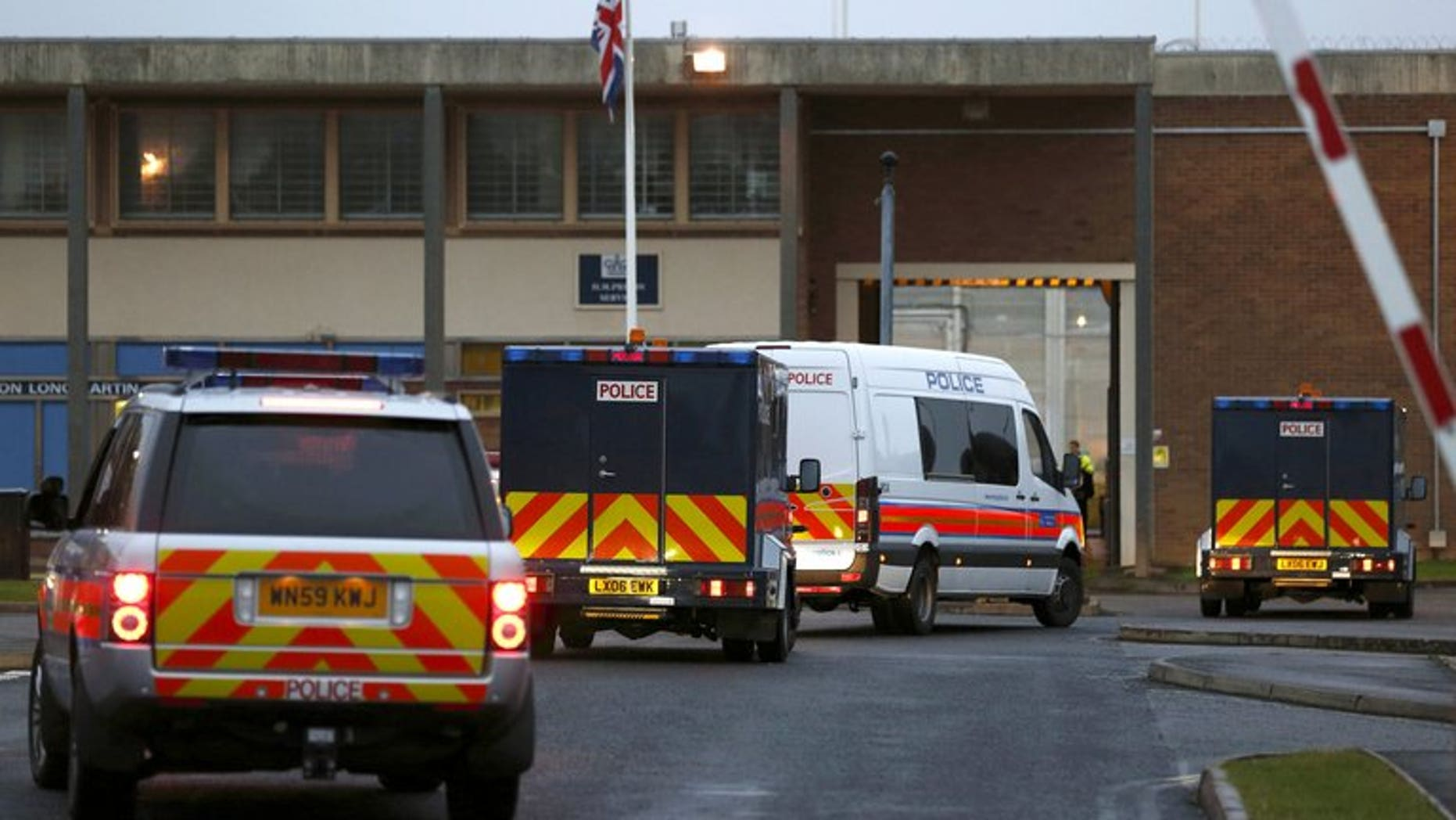 """A police motorcade, including armoured vehicles, arrives at Long Lartin prison in central England, on October 5, 2012. Europe's rights court on Tuesday ruled that whole-life prison terms imposed in Britain amounted to """"inhuman and degrading"""" treatment, in a case brought by three of the country's most notorious murderers."""