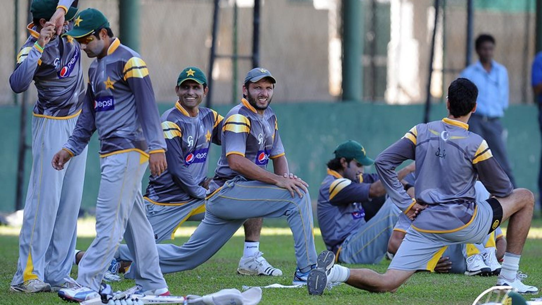 Pakistan cricketers stretch during an ICC Twenty20 Cricket World Cup practise session in Colombo on October 3, 2012. Pakistan announced the schedule for its series against South Africa in October, involving two Tests, five one-day matches and two Twenty20 games.