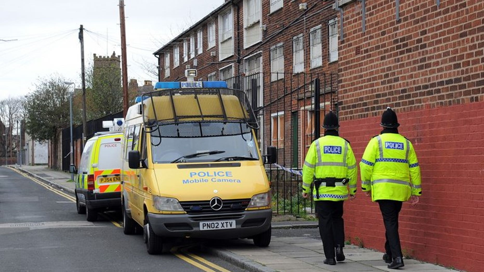 """Police officers patrol in Liverpool, northwest England, on April 10, 2009. An British online """"troll"""" who sparked a security alert in the United States by threatening on Facebook to kill 200 schoolchildren was jailed on Tuesday for two years and four months."""