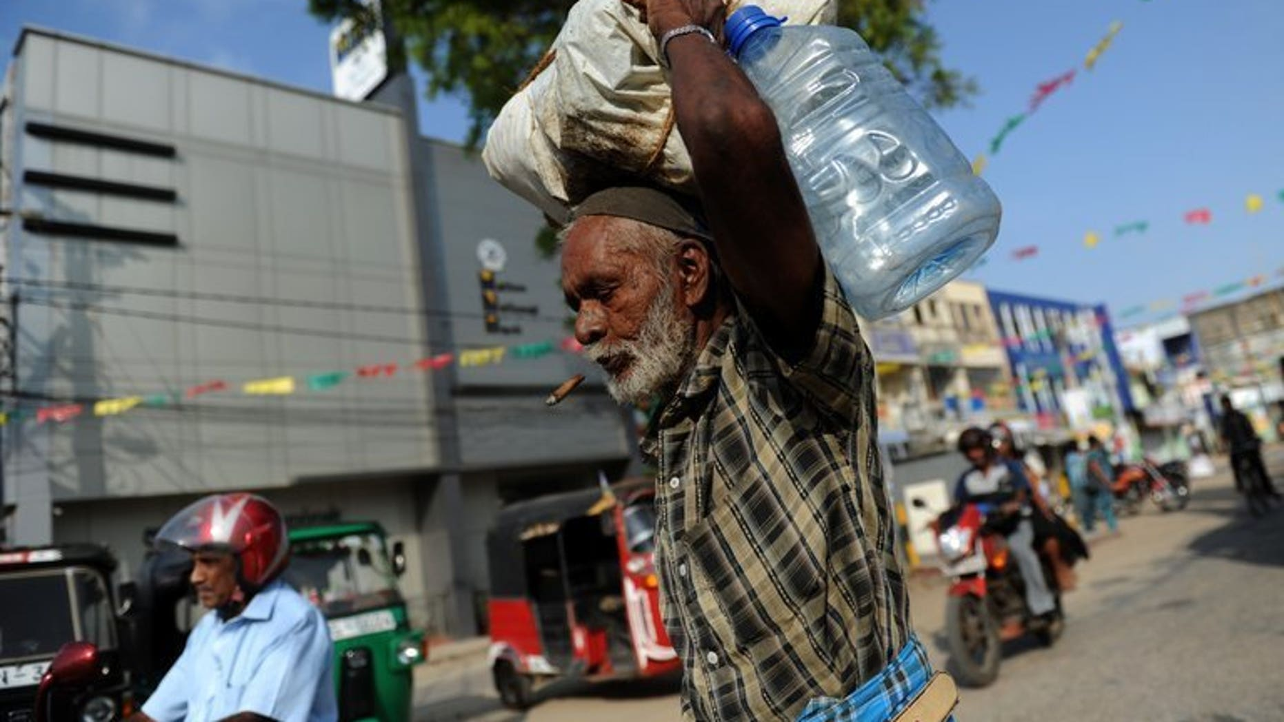 A Sri Lankan Tamil man walks through Jaffna, on May 4, 2012. India has urged Sri Lanka to honour international pledges and share political power with ethnic Tamils after Colombo signalled it will dilute an Indian-brokered devolution plan.