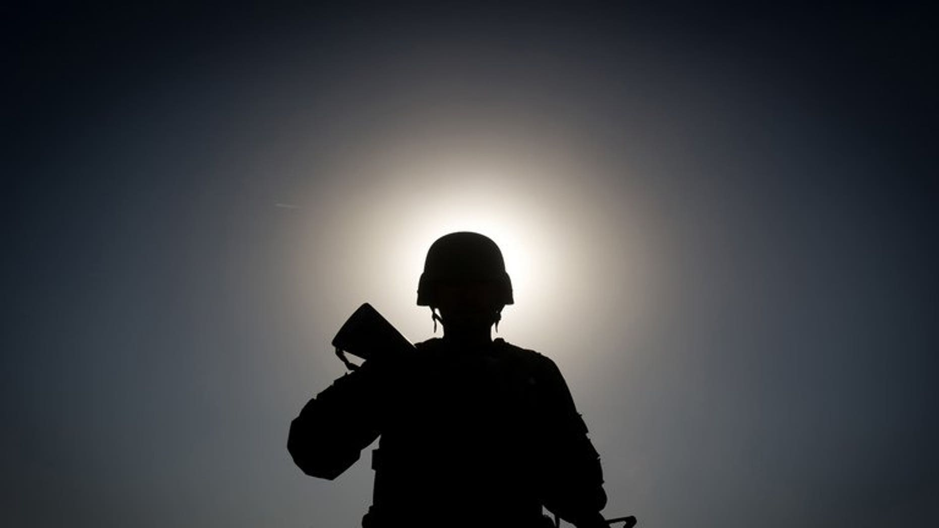 """An Afghan soldier on patrol near Kandahar, on November 28, 2010. An Afghan soldier has shot dead his Slovakian counterpart in the latest """"insider attack"""" to shake efforts by the NATO coalition and the Afghan army to work together to defeat the Taliban insurgency."""