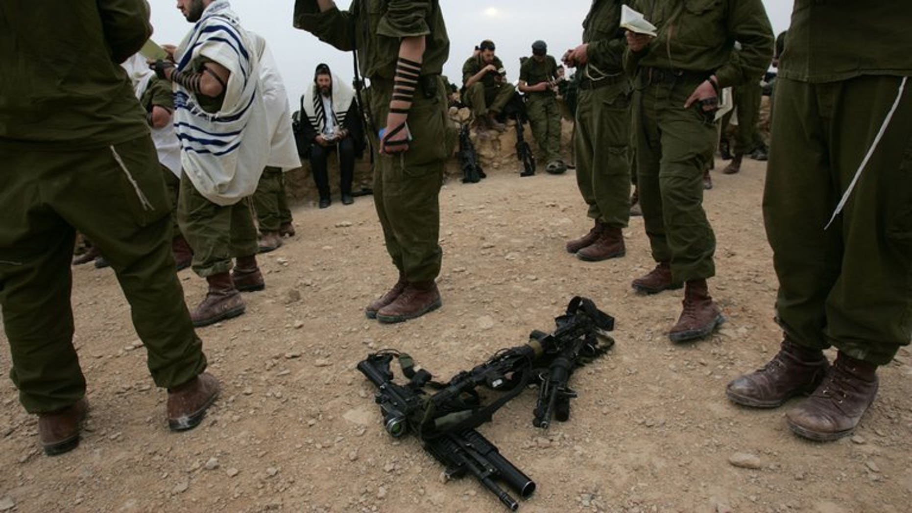 Israeli soldiers from an Ultra Orthodox battalion pray on the top of the ancient fortress of Masada in the Judean desert on March 23, 2007. Israeli police on Tuesday rescued an ultra-Orthodox soldier who was attacked by a group of his coreligionists in Jerusalem's Mea Shearim neighbourhood, a spokesman said.