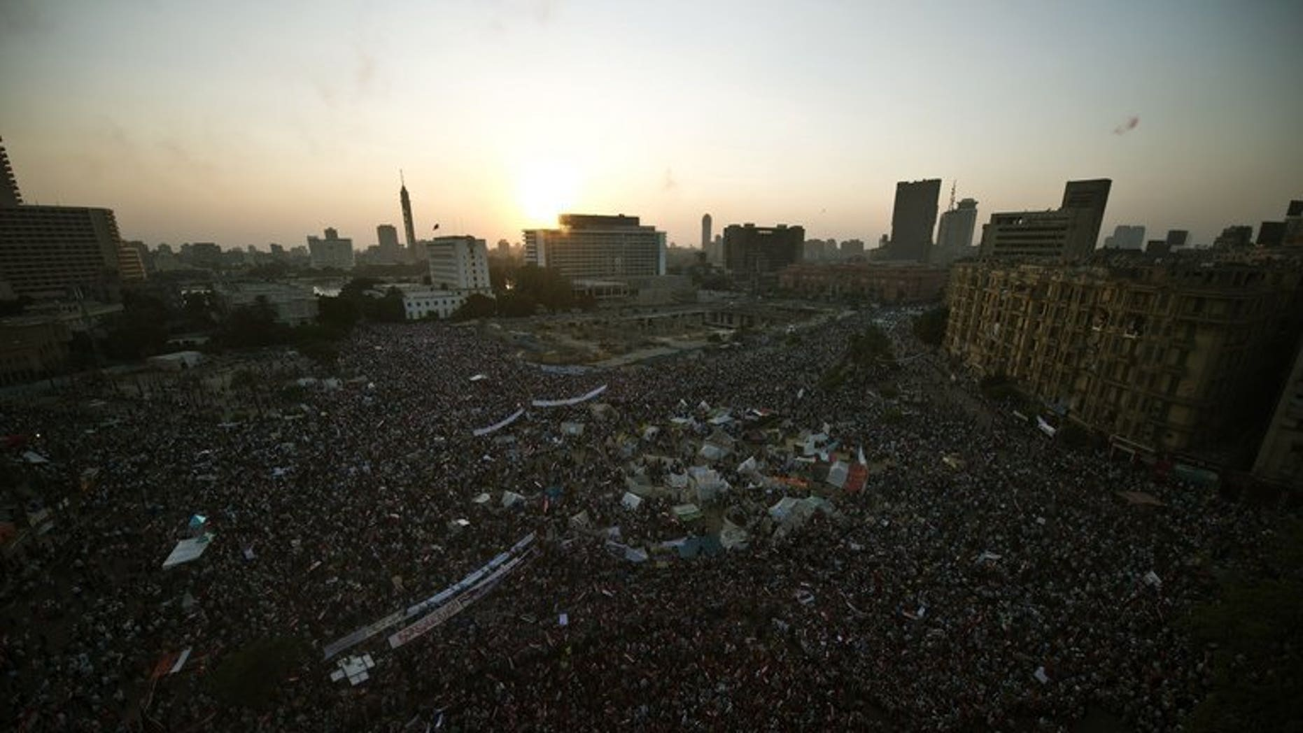 Thousands of Egyptians rally on July 7, 2013 in Cairo's Tahrir Square. Saudi Arabia said on Tuesday that it would give Egypt $5 billion (3.9 billion euro) in assistance for its economy, six days after the army toppled Islamist president Mohamed Morsi.