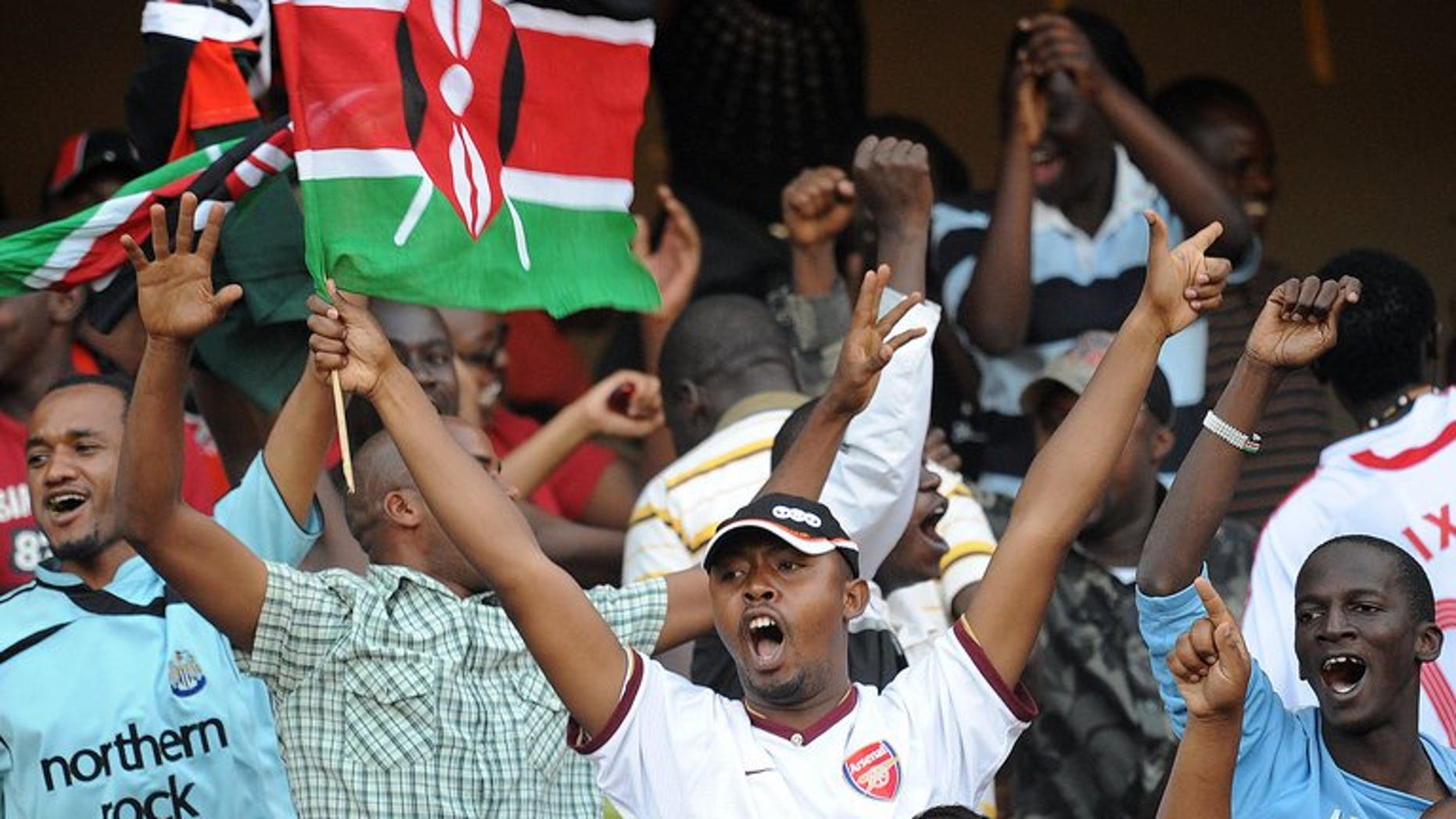 Kenyan soccer fans celebrate at the Moi International Sports Centre Kasarani in Nairobi on November 14, 2009. An Edwin Lavatsa brace gave Kenya a 2-0 win over Swaziland Tuesday and top place in Group B of the Cosafa Cup.