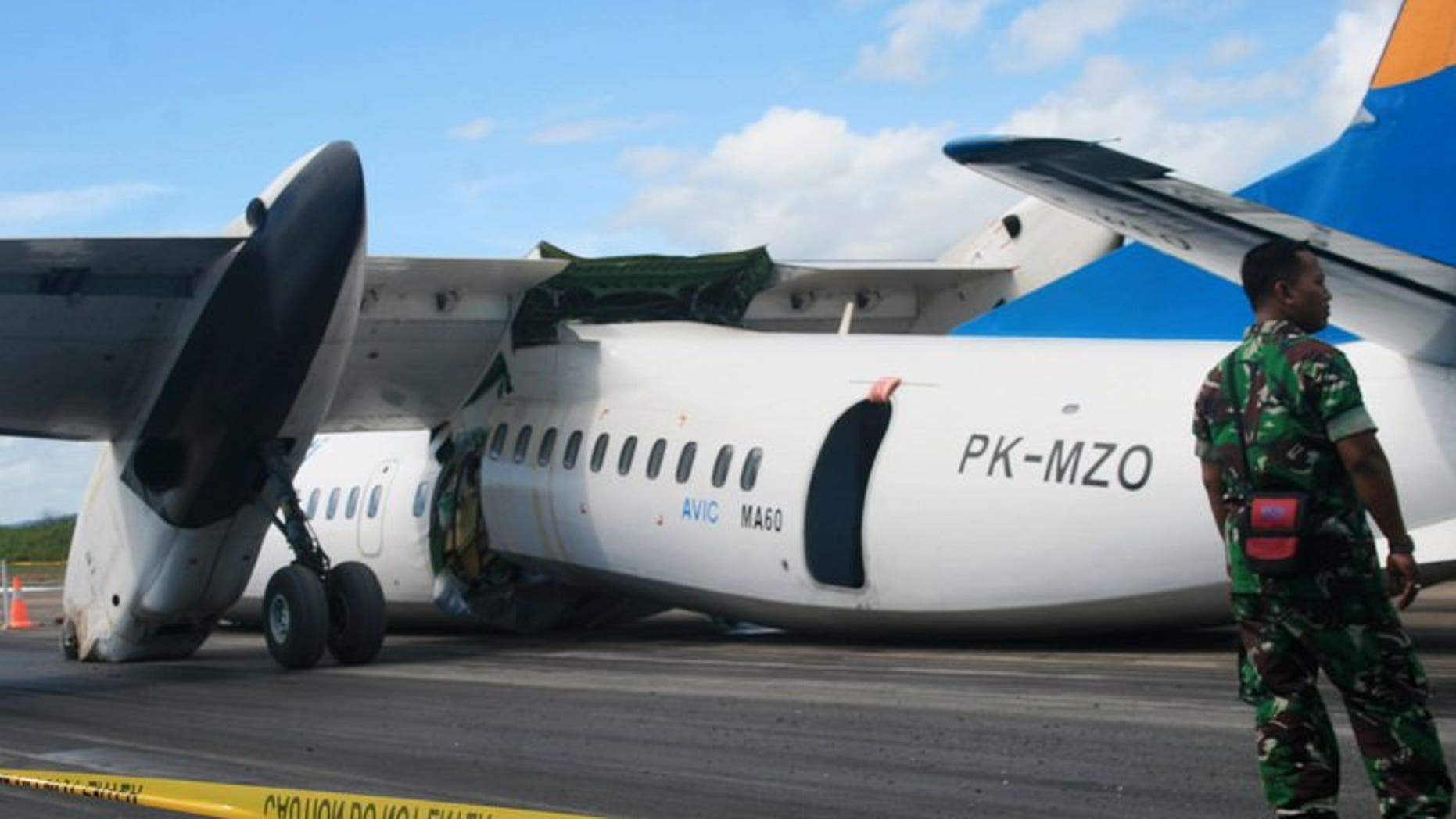 An Indonesian soldier stands guard next to an MA60 Merpati Airlines plane after it crash-landed in Kupang on June 10, 2013. New Zealand said it had suspended a multi-million-dollar aid programme in Tonga over safety concerns stemming from the Pacific nation's plans to use the Chinese-made plane for domestic services.