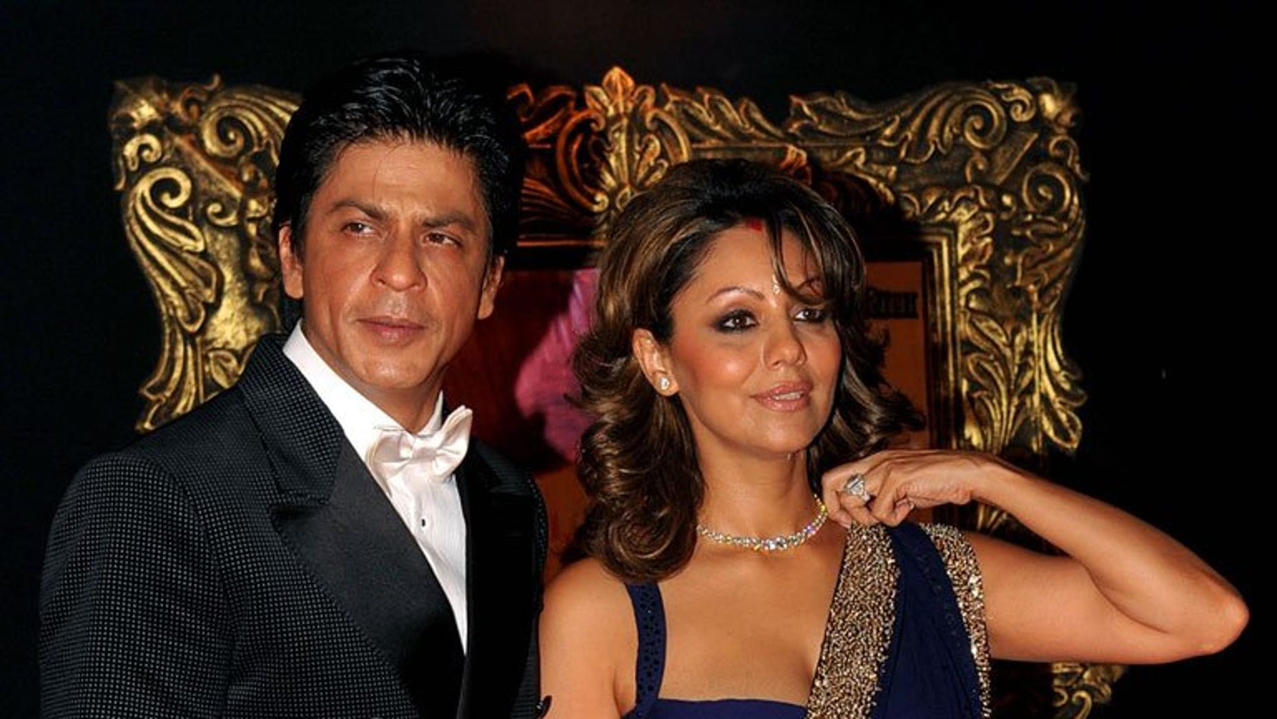 """Bollywood star Shah Rukh Khan and his wife Gauri at the premiere of """"Jab Tak Hai Jaan"""" in Mumbai on November 12, 2012. The couple have announced the arrival of their new baby boy born to a surrogate mother, and denied rumours of an illegal pre-natal gender test."""