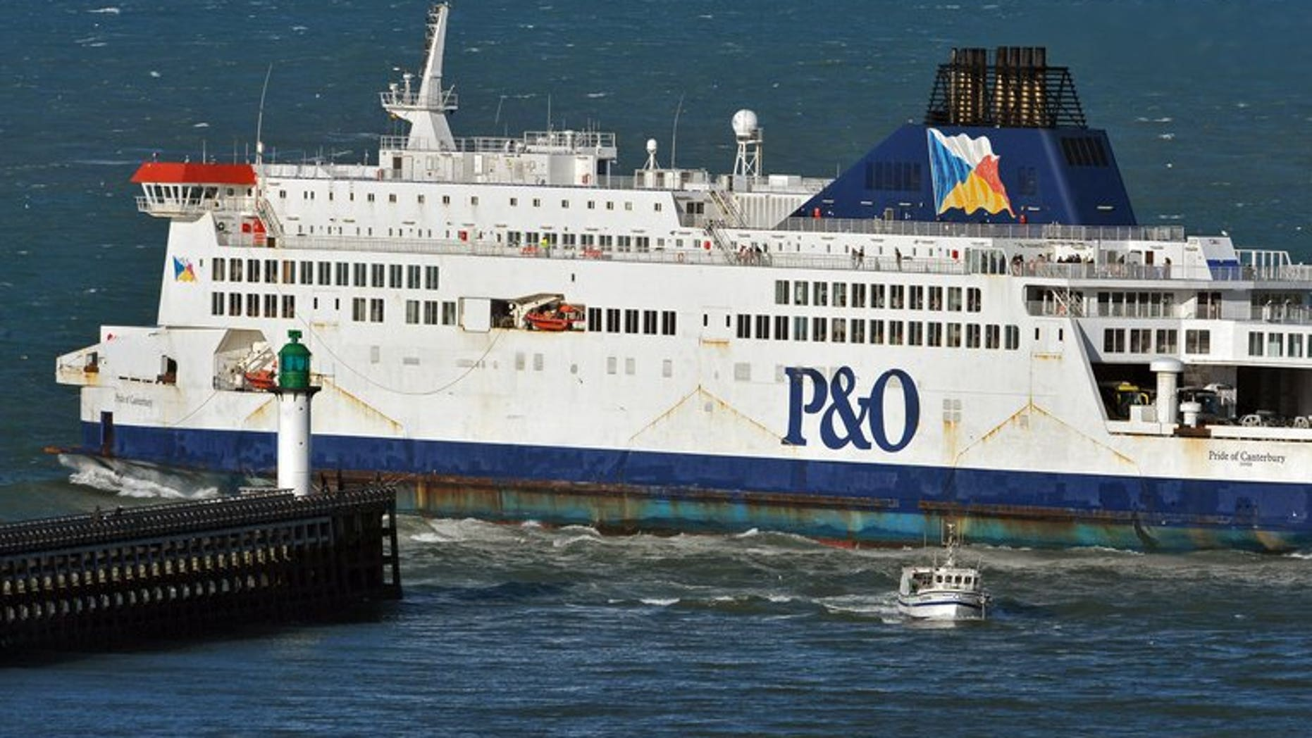 P&O ferry Pride of Canterbury leaves Calais harbour, northern France, for Dover on January 2, 2012. Police have arrested two people after 15 asylum seekers were found hidden in a tanker on board a ferry at the port of Dover.