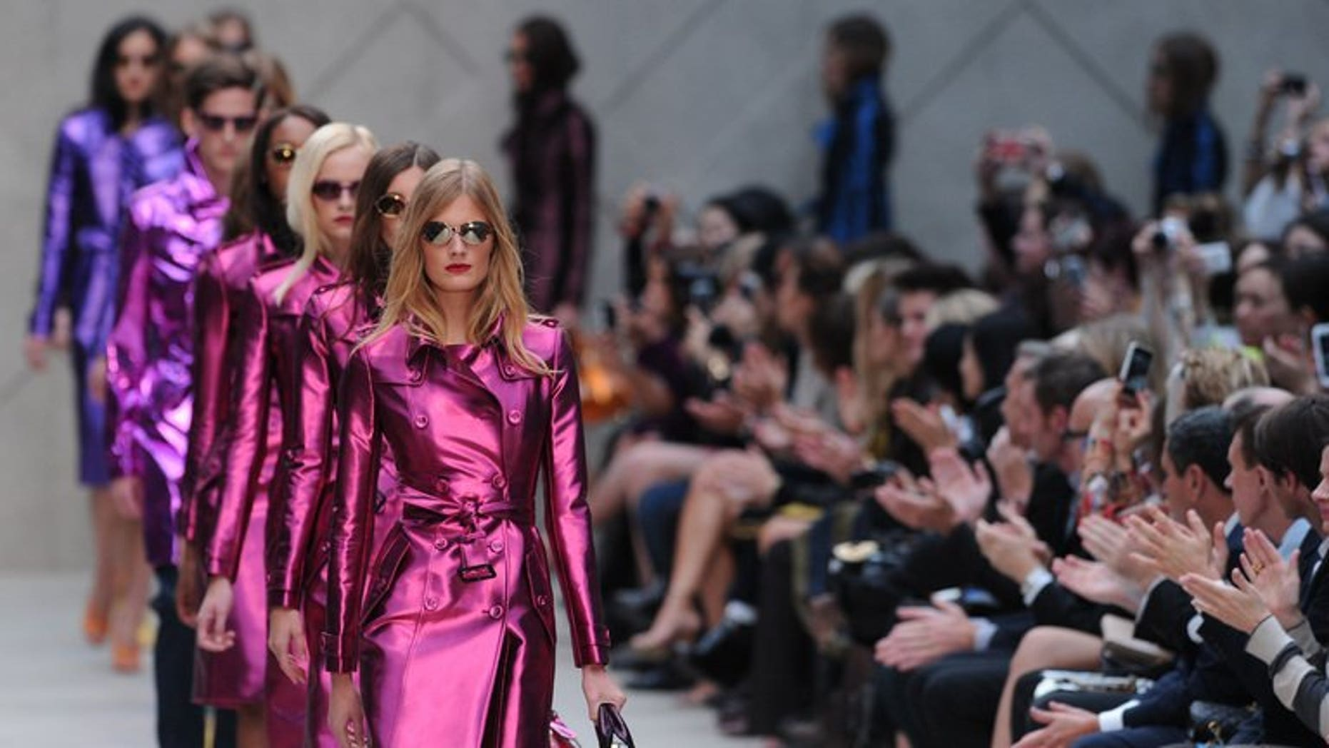 Models present the Burberry Prorsum 2013 spring/summer collection at London Fashion Week on September 17, 2012. British luxury clothing and handbag maker Burberry says sales rose in its first quarter, boosted by strong growth in the Asia Pacific region and in the Americas.
