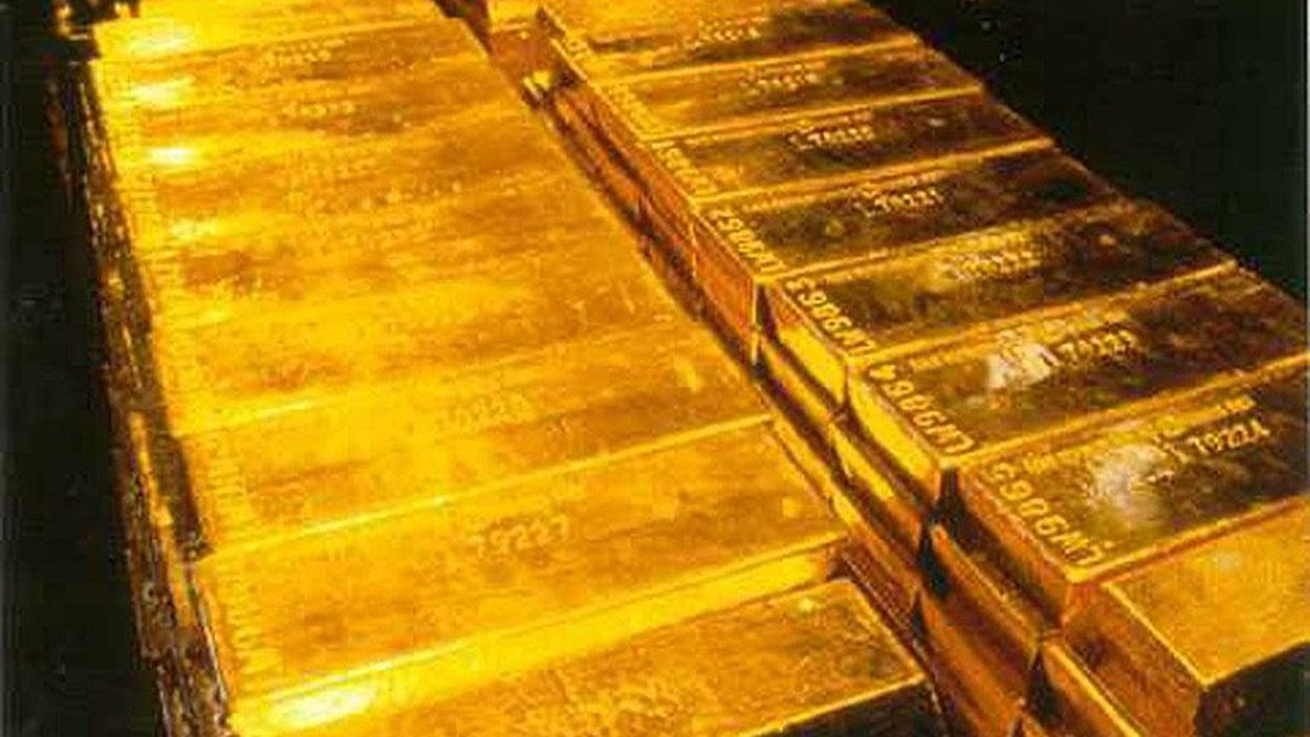 Gold bullion is stored inside a high-security vault in London, on September 28, 1999. Nepal police have seized 35 kilograms (77 pounds) of gold, smuggled over the border from China and bound for India, where demand for the precious metal is soaring.