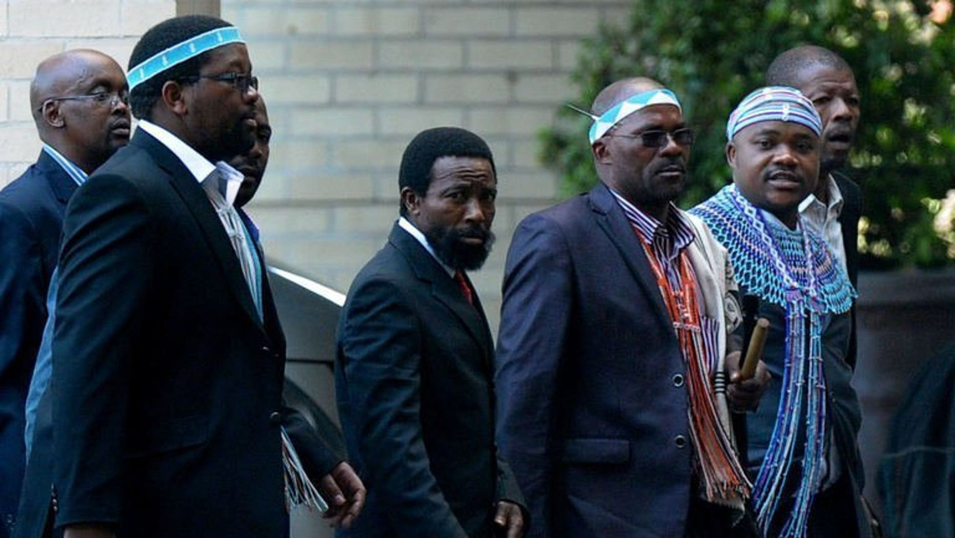 Thembu King Buyelekhaya Dalindyebo (C) flanked by chiefs, arrives on July 9, 2013 to visit former South African President Nelson Mandela at the MediClinic Heart Hospital in Pretoria. Nelson Mandela is conscious and recognises visitors, the king of his Thembu tribe told AFP Wednesday, after visiting the global icon in hospital.